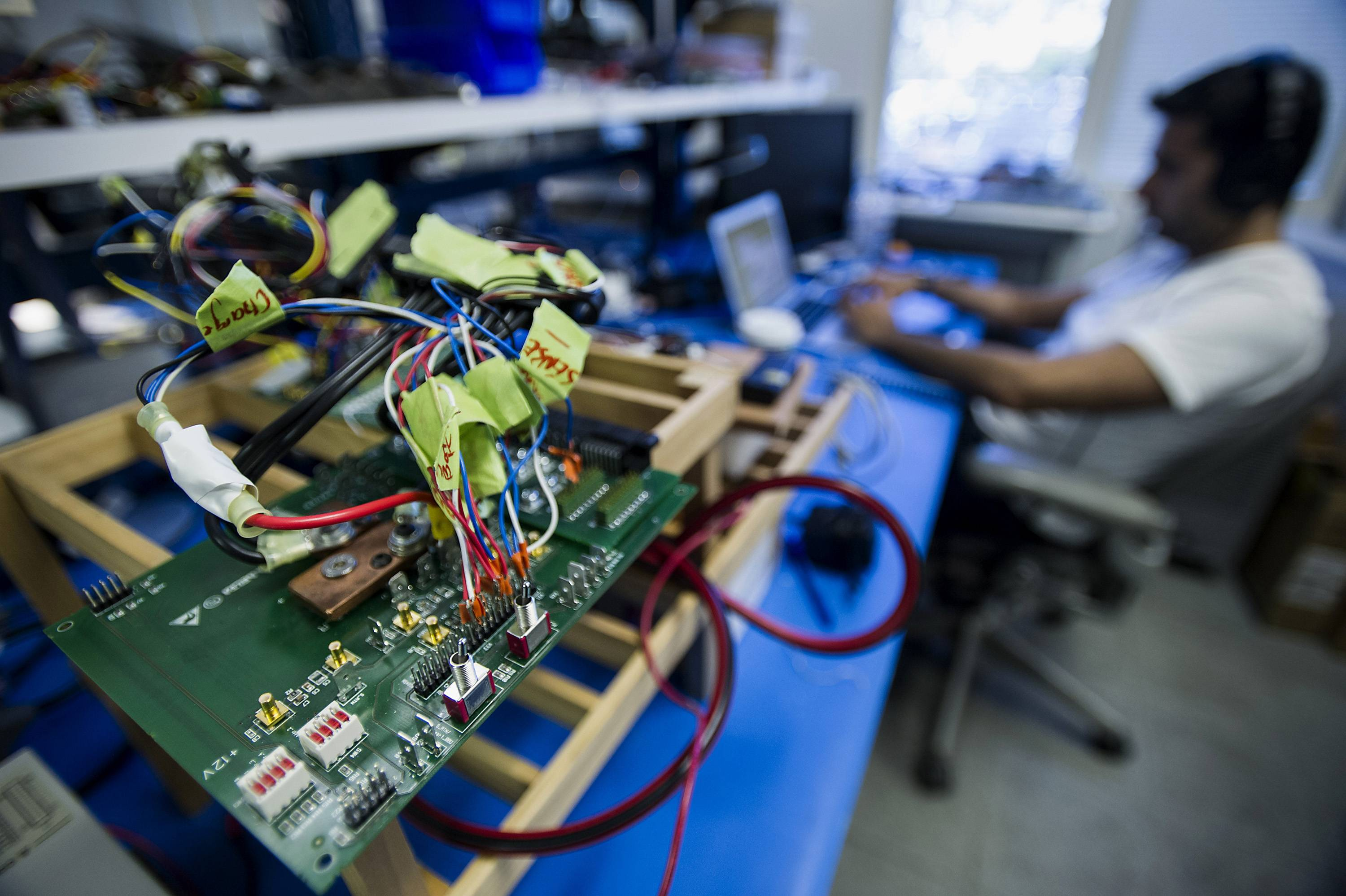 A technician works on a computer Monday while testing servers at the Facebook Inc. hardware labs in Menlo Park, Calif.