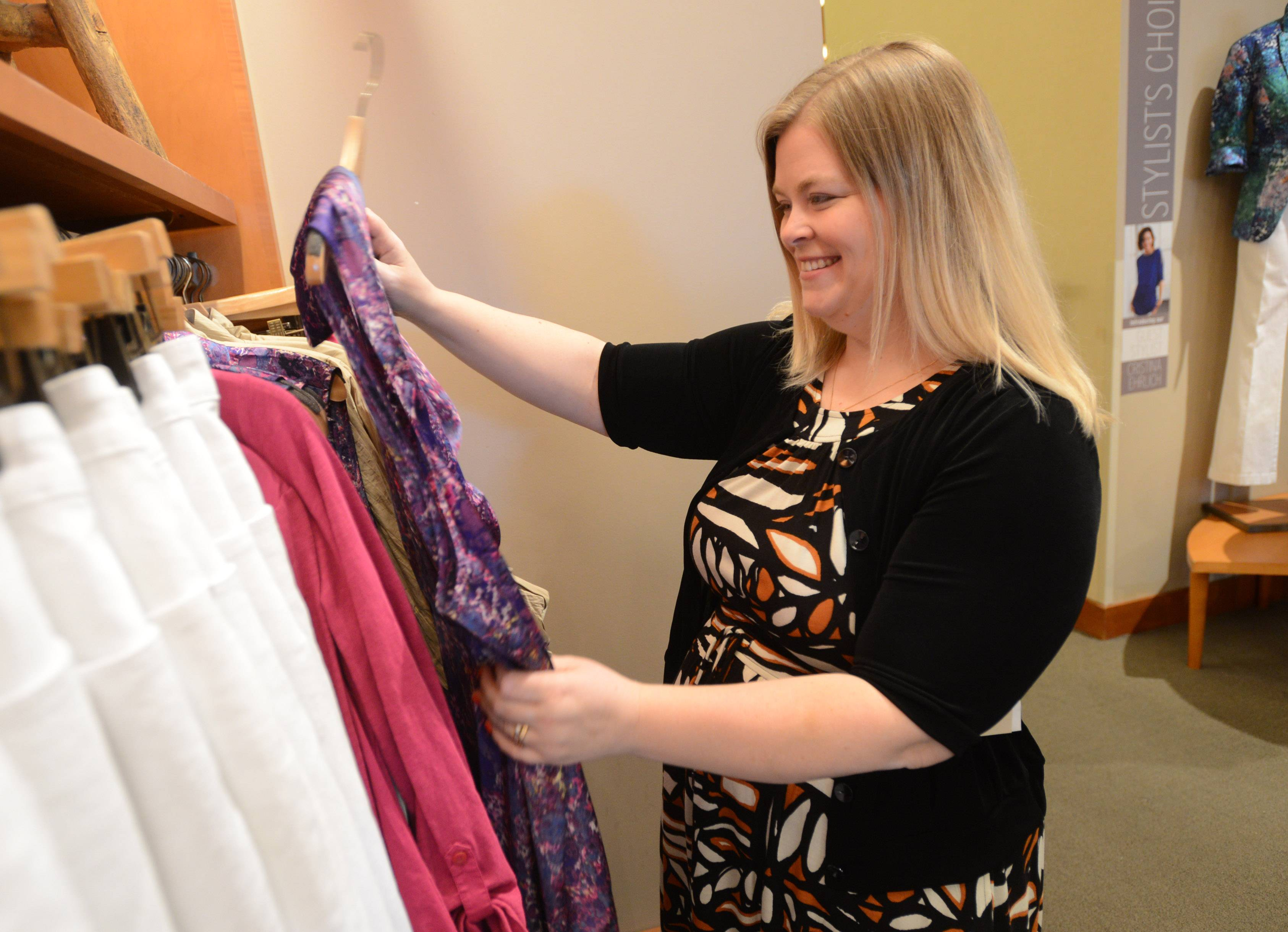 Megan McCarthy-Cook of Hoffman Estates looks for clothes at Deer Park's Coldwater Creek store in this file photo. The Deer Park store, and others owned by Coldwater Creek, will be closing due to the company's bankruptcy.