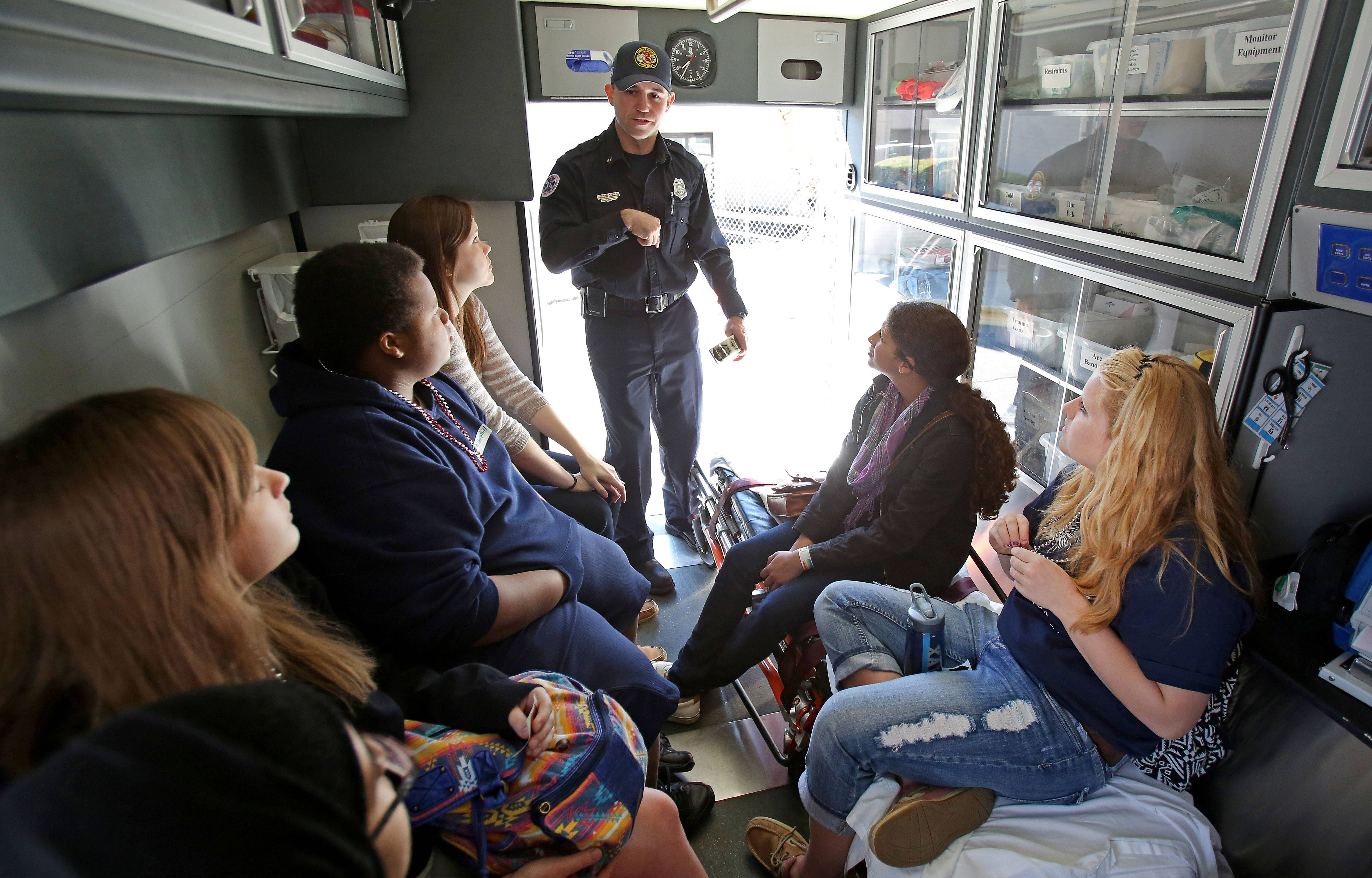 Libertyville Firefighter/Paramedic Mike Weaver offers Libertyville High School students a look inside an ambulance Friday during Trauma Day at Advocate Condell Medical Center in Libertyville.