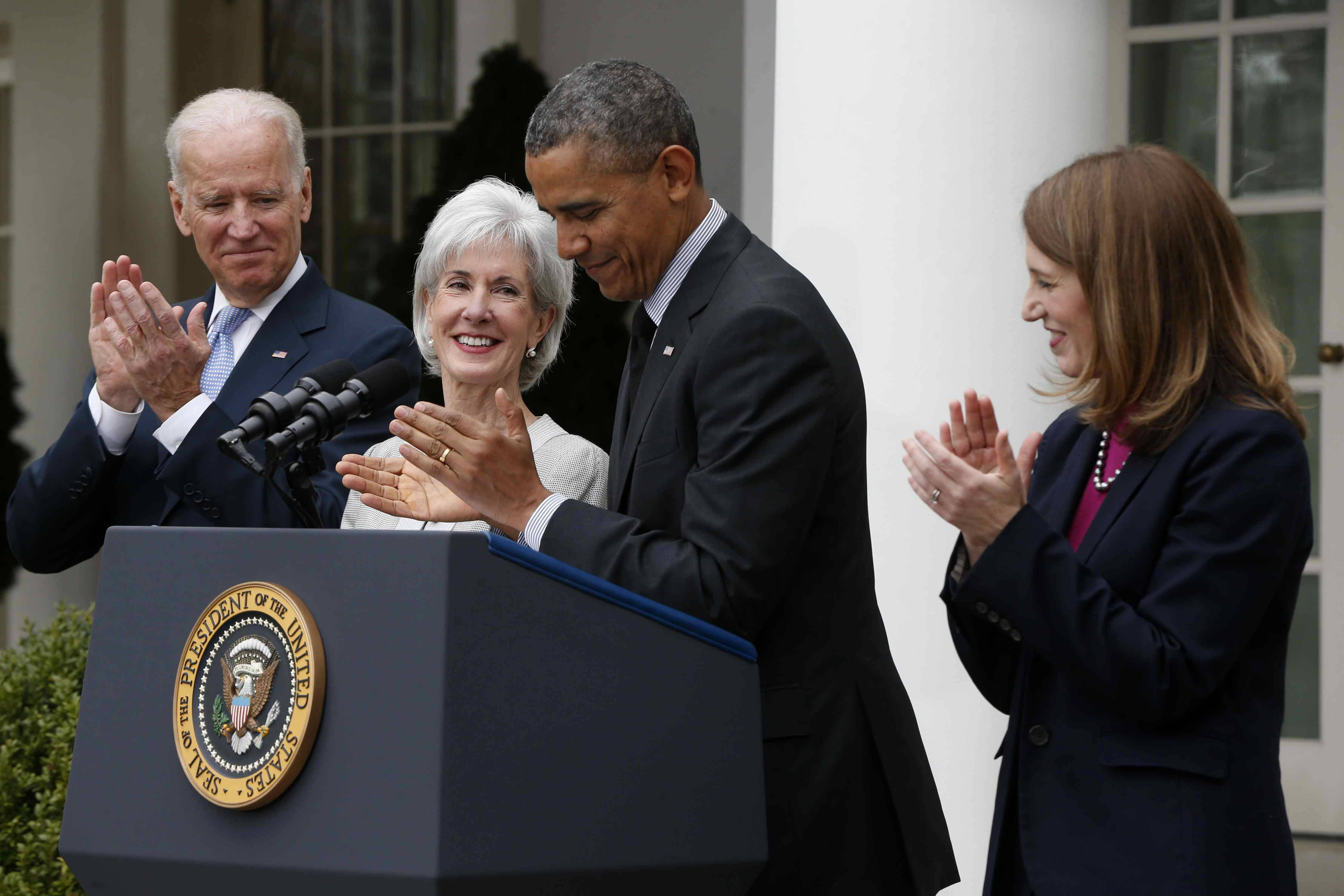 President Barack Obama and Vice President Joe Biden stand with outgoing Health and Human Services Secretary Kathleen Sebelius, second from left, and his nominee to be her replacement, Budget Director Sylvia Mathews Burwell, Friday, April 11, 2014, in the Rose Garden of the White House in Washington.