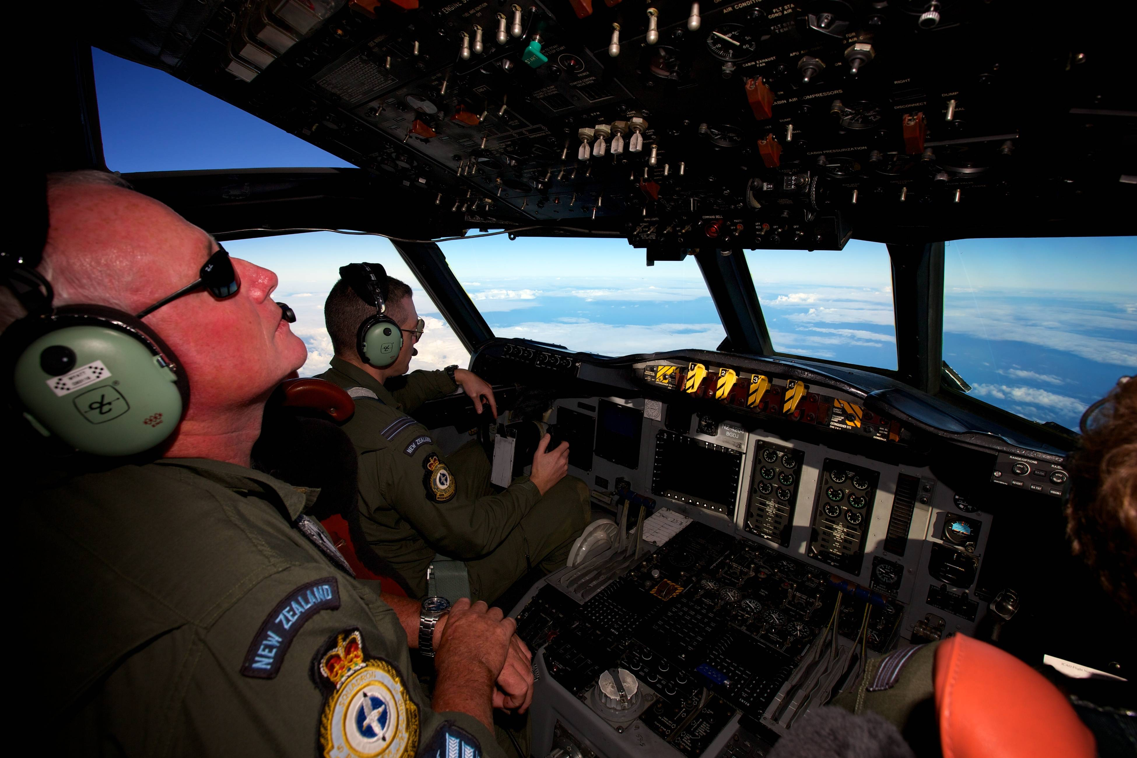 A Royal New Zealand Air Force P-3 Orion is flown by Flt. Lt Tim McAlevey back, in the search for missing Malaysia Airlines Flight MH370 over the Indian Ocean, Friday, April 11, 2014. Authorities are confident that signals detected deep in the Indian Ocean are from the missing Malaysian jet's black boxes, Australia's Prime Minister Tony Abbott said Friday, raising hopes they are close to solving one of aviation's most perplexing mysteries.