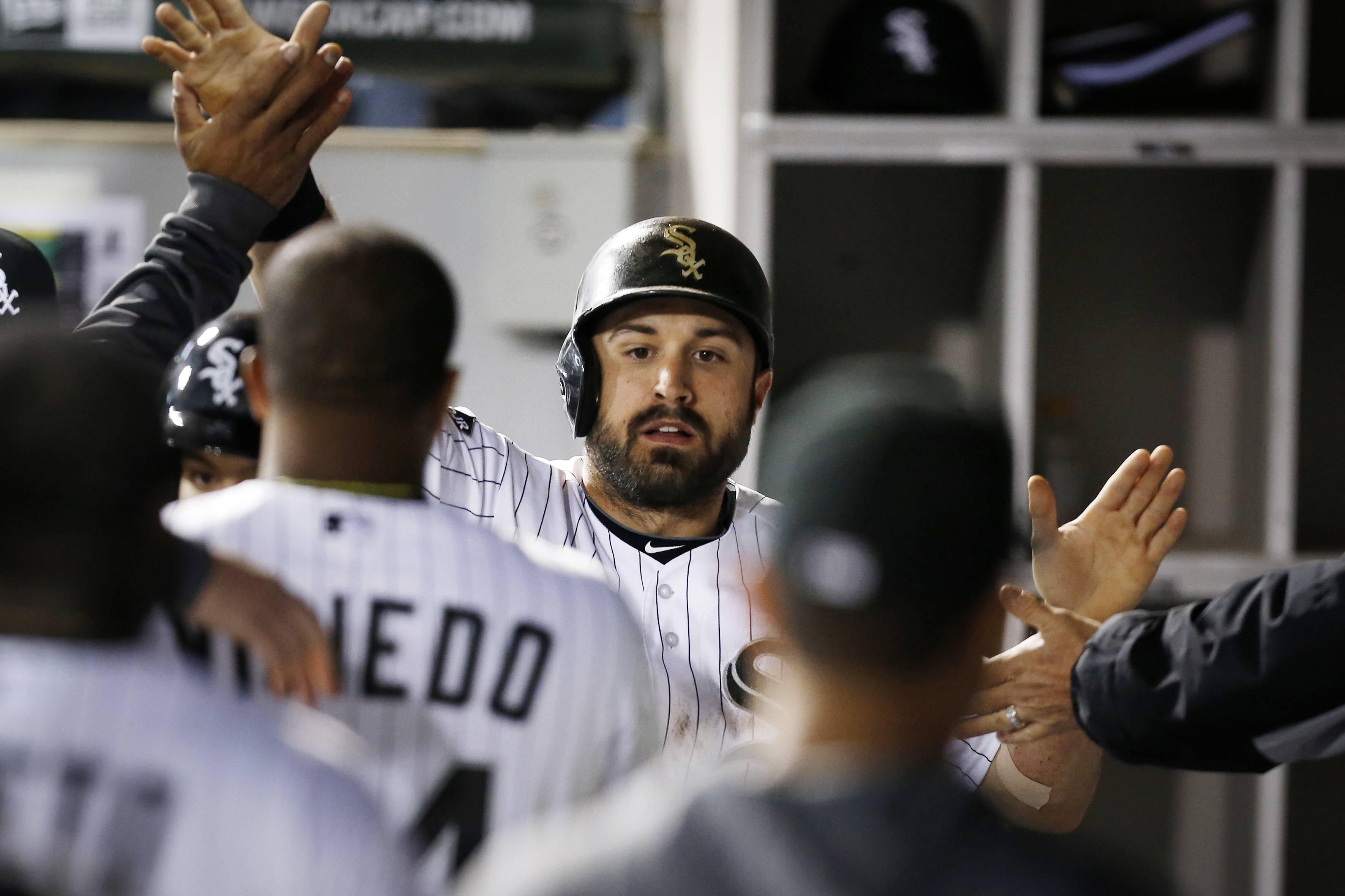 Adam Eaton celebrates after scoring an eighth-inning run against Cleveland on Friday. Eaton, now batting .333, reached on a two-out drag bunt down the first-base line.