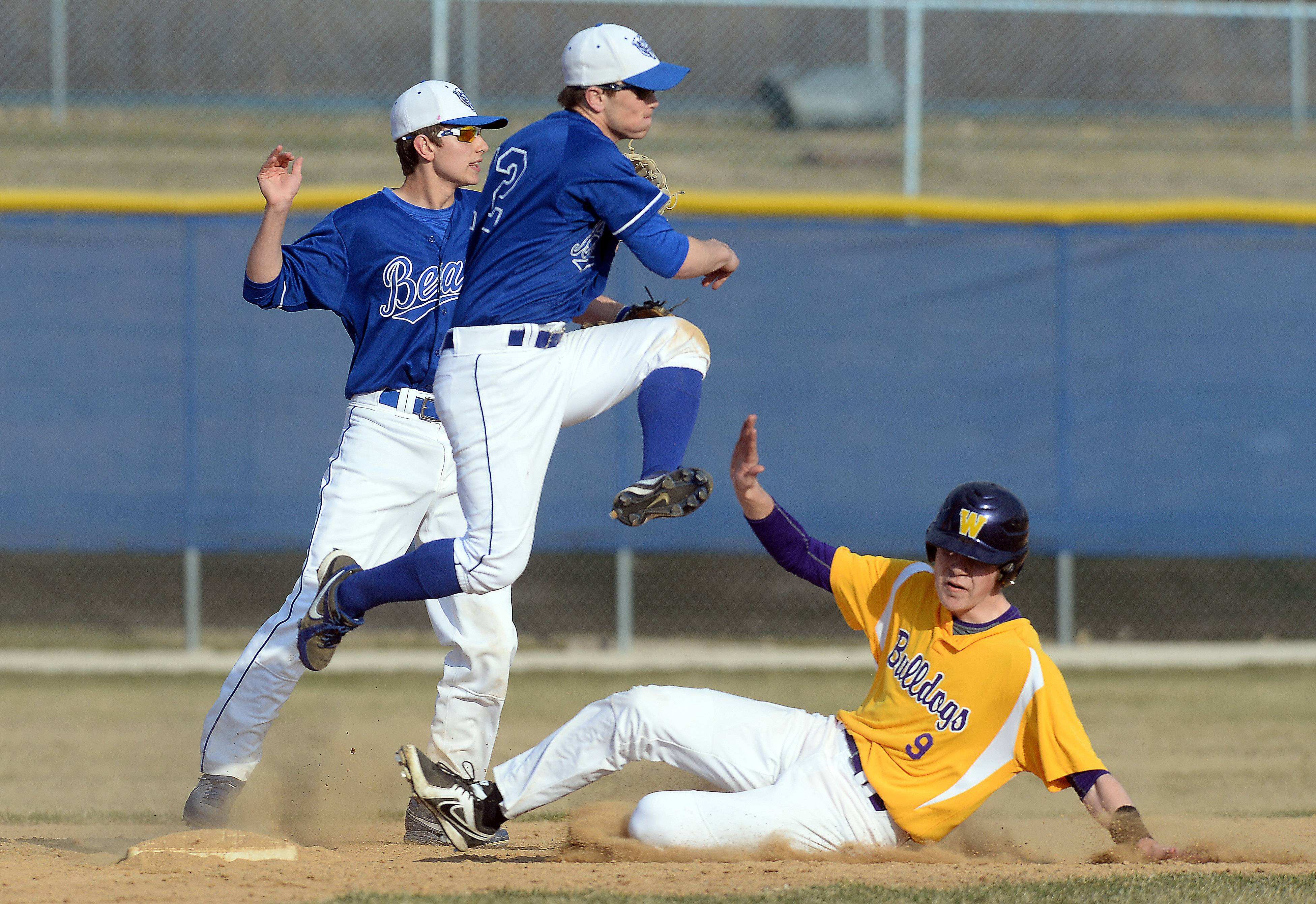 Lake Zurich shortstop Danny Neises throws to first after forcing out Wauconda's Kevin Malisheski at second on a sequence started by Wauconda's Mitchell Sharkey on Friday at Lake Zurich.