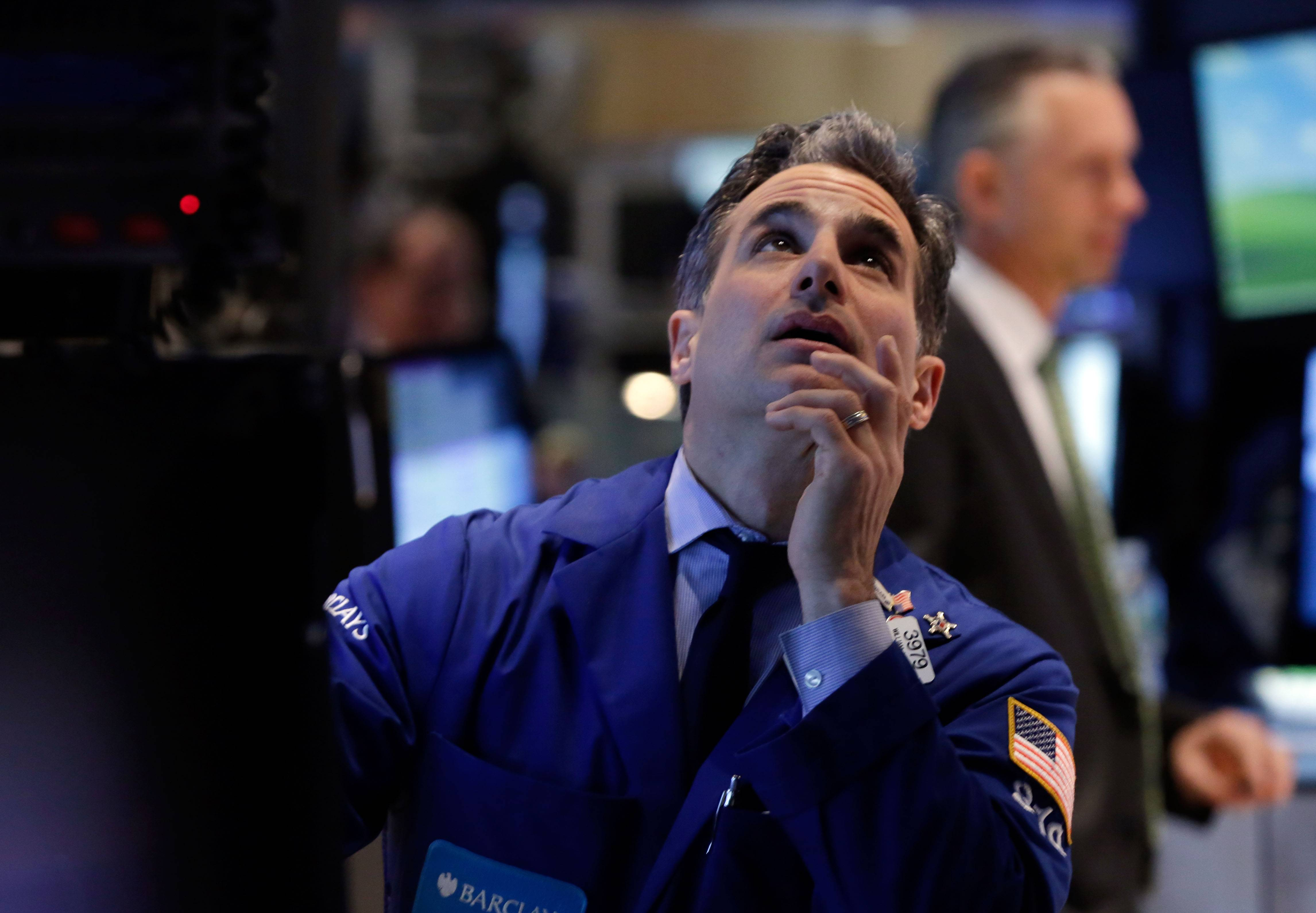 Specialist Anthony Rinaldi works at his post Friday on the floor of the New York Stock Exchange.