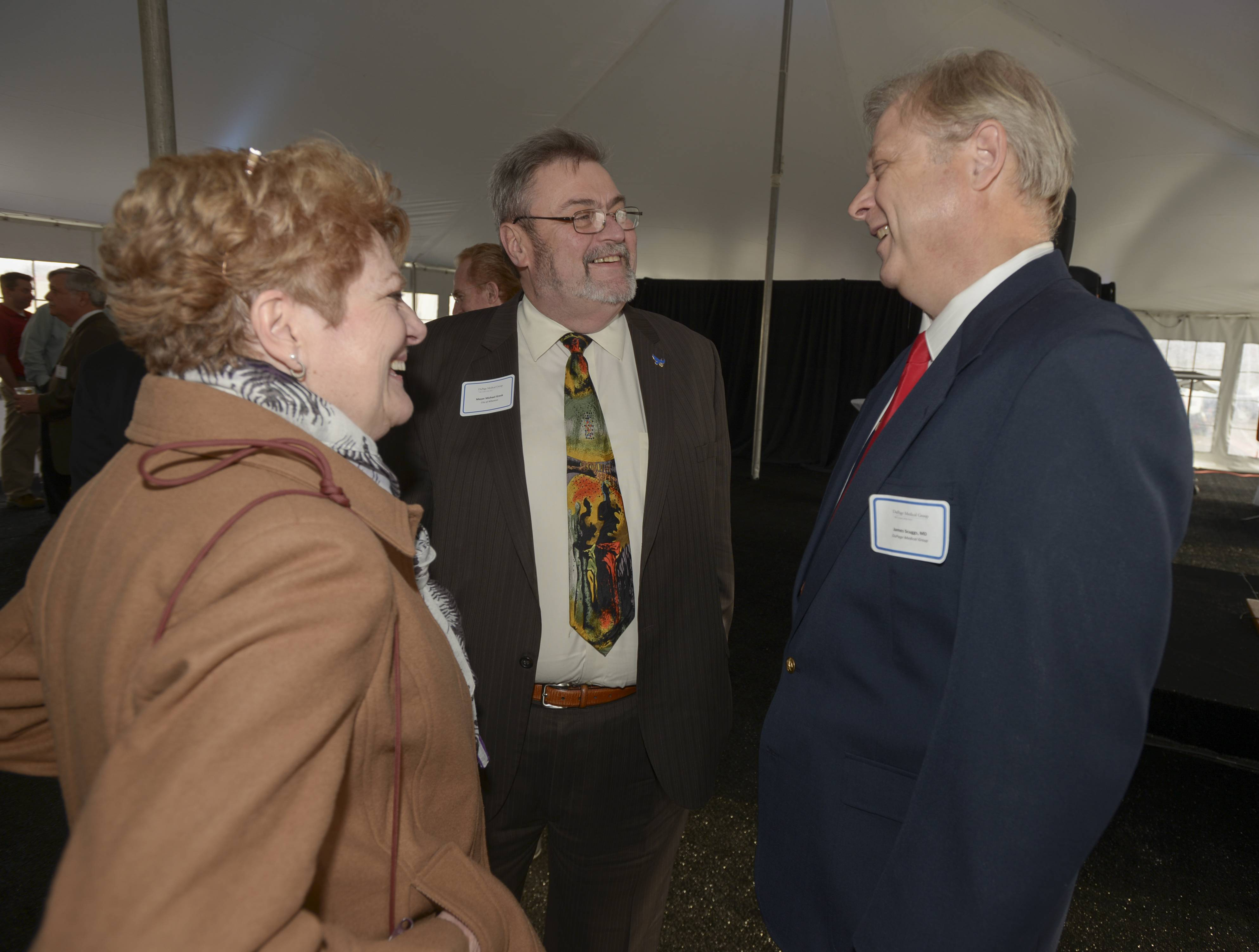 Kathleen Gresk and her husband Wheaton Mayor Mike Gresk talk with Dr. James Scugges before the ribbon cutting ceremony for the new DuPage Medical Group Building in Wheaton.