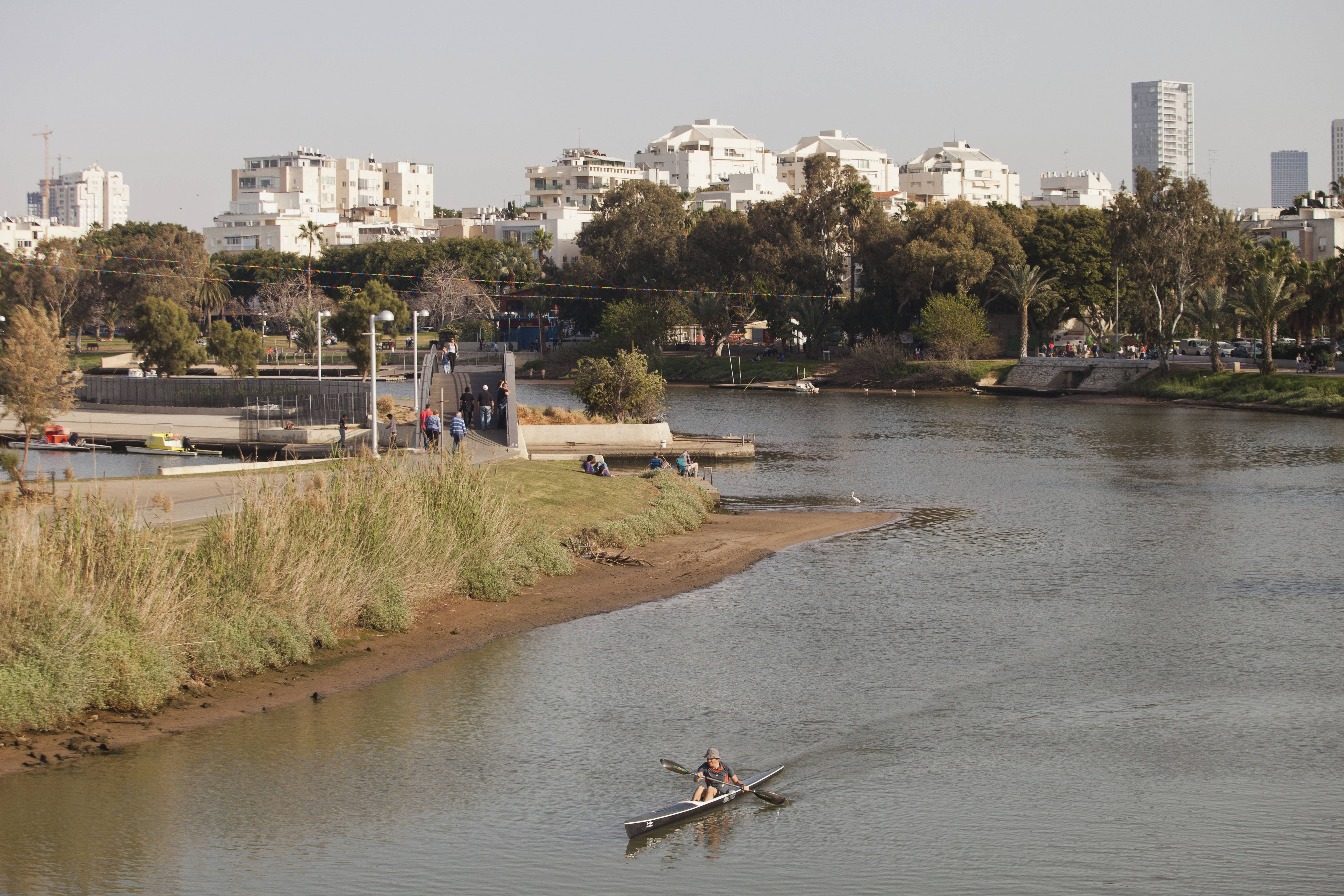 People kayak through Yarkon Park in Tel Aviv, Israel. The city's primary open space sits along the Yarkon River and offers a perfect place for a jog, a stroll or a picnic.