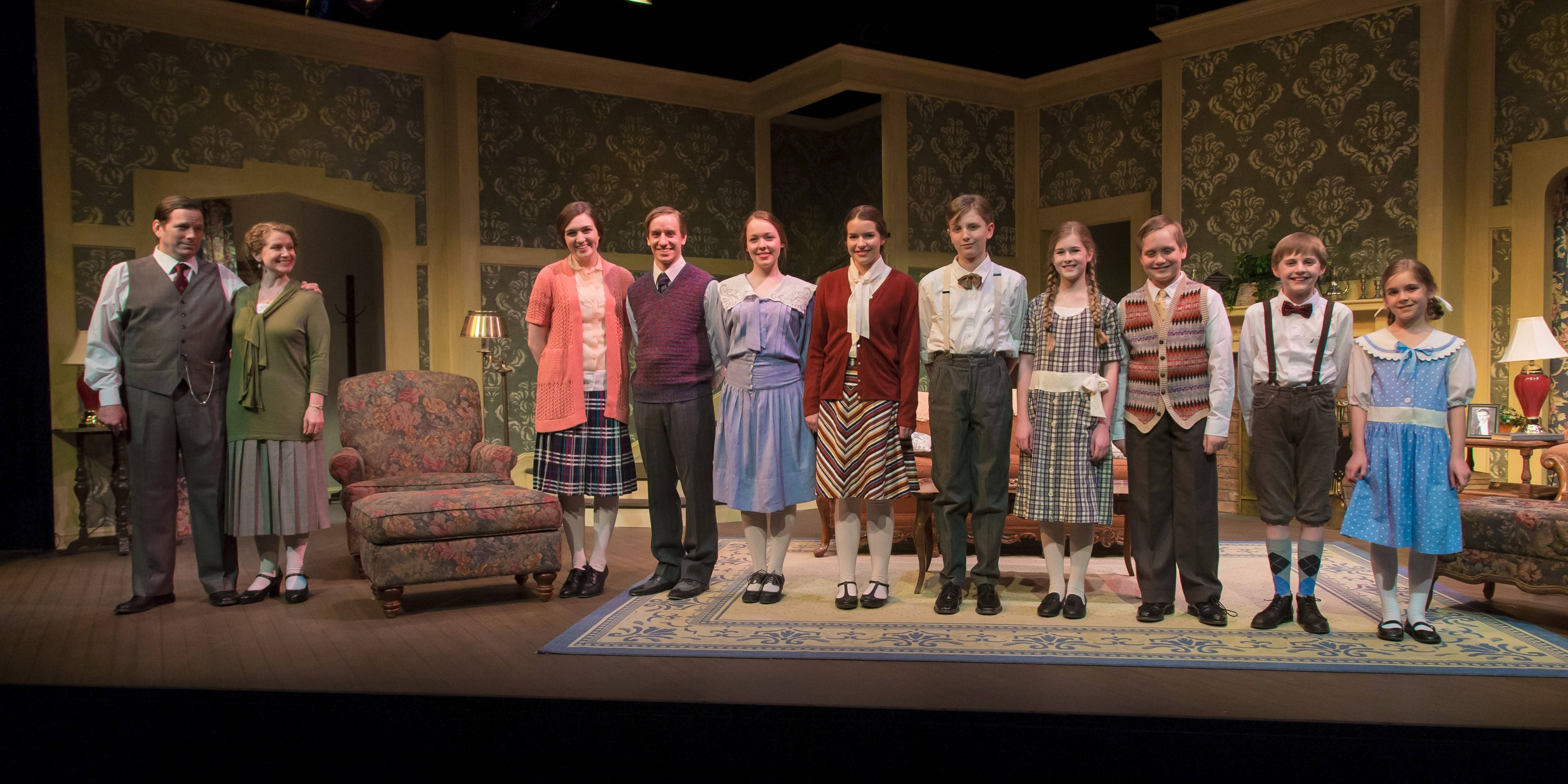 "Efficiency experts Frank (Michael Dailey, left) and Lillian (Laura Sturm, second from left) apply their productivity theories to their family in ""Cheaper by the Dozen,"" running through May 18 at Fox Valley Repertory in St. Charles. Playing the children are, from left, Kelsey Sante, Josh Greiveldinger, Grace Etzkorn, Rachel Becker, Keaton Jens, Erika Denker, Ewan Parker-Eaton, Nathan Castagna and Keira Denker."
