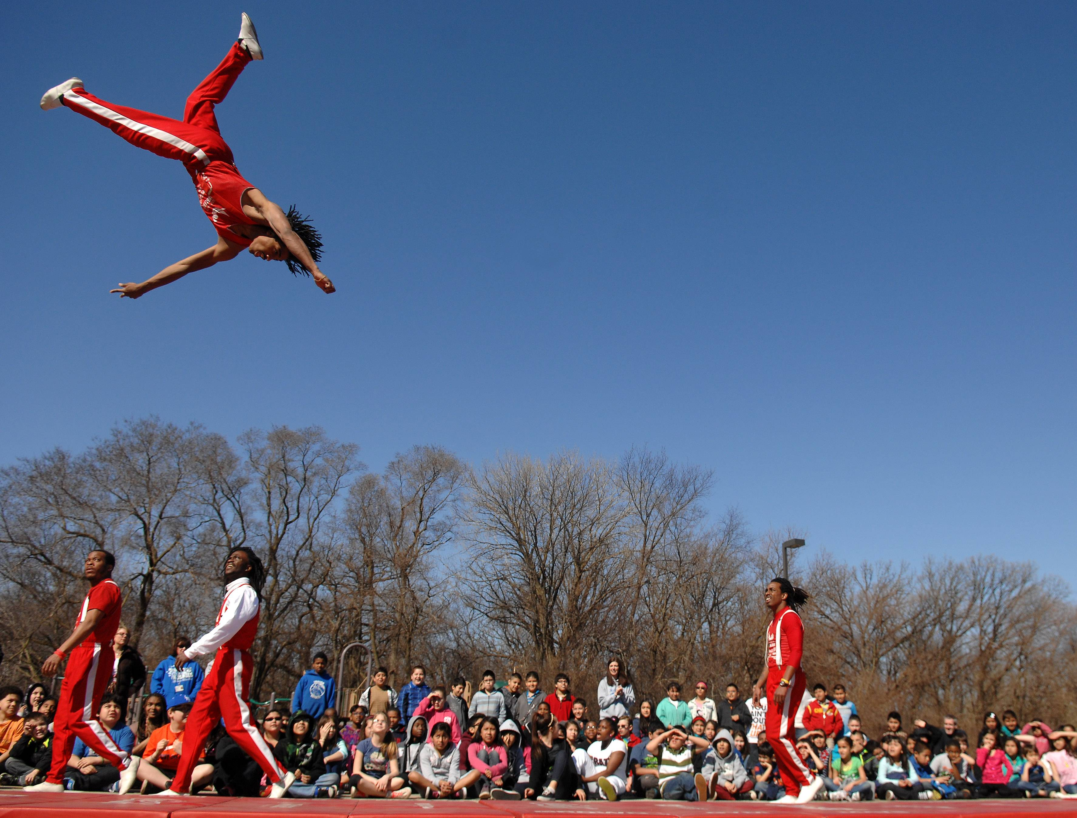 Students look on as the Jesse White Tumblers perform Friday at Hillcrest Elementary School in Elgin.