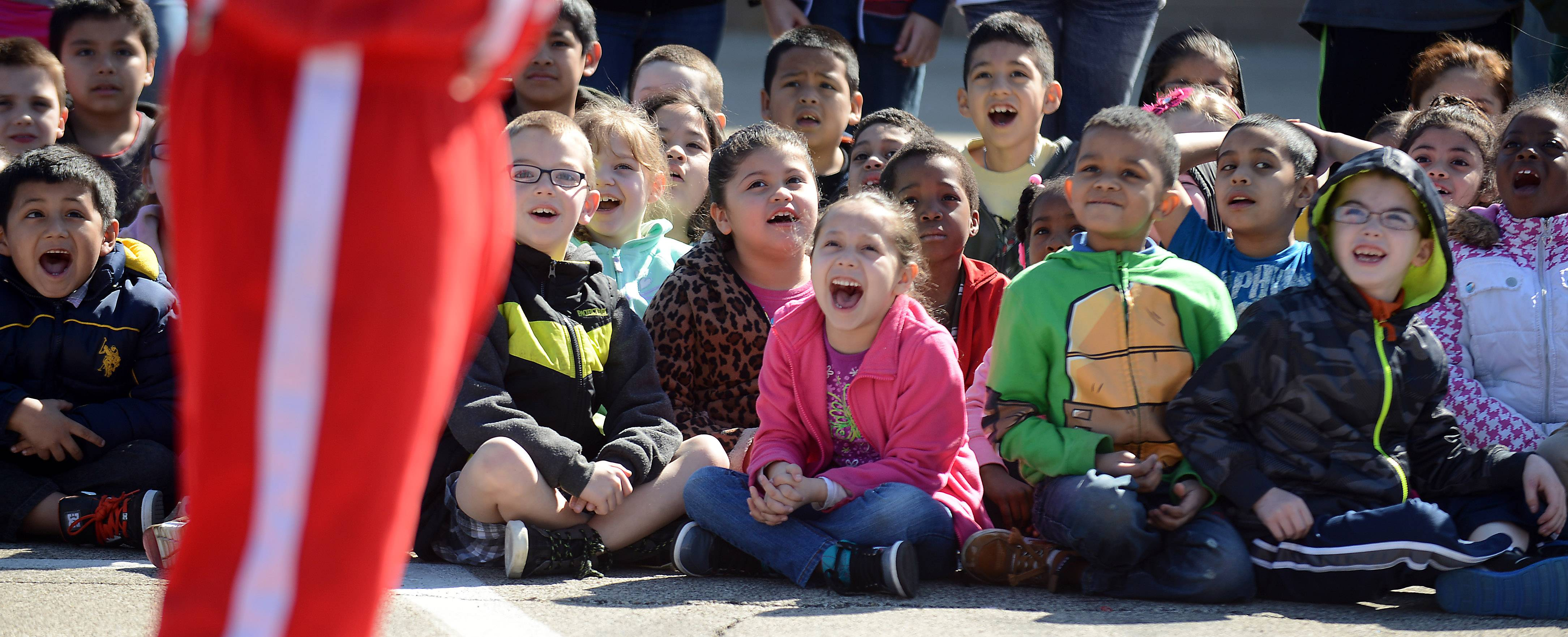 Students cheer loudly for tumblers Friday at Hillcrest Elementary School in Elgin.