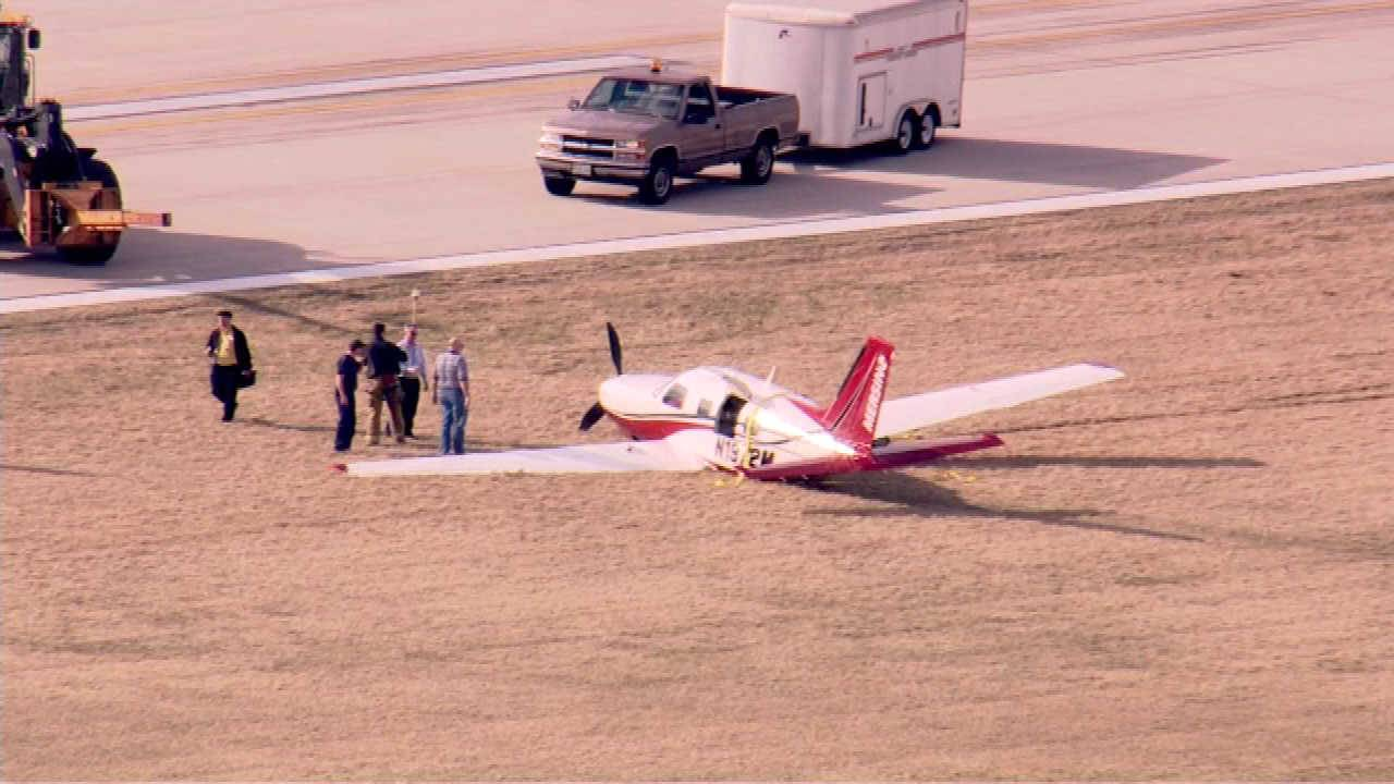 COURTESY OF ABC7 CHICAGOPersonnel tend to an airplane off the runway at DuPage Airport on Friday.