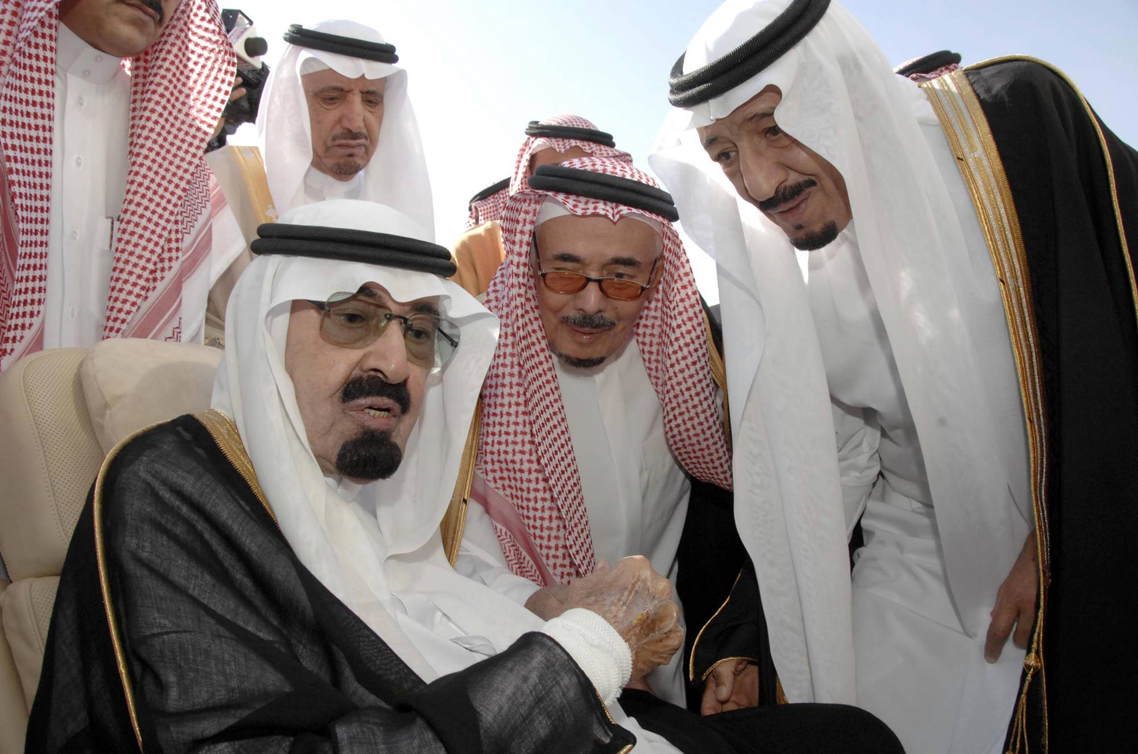 Saudi Arabia's King Abdullah, left, speaks with Prince Salman, the Saudi King's brother and Riyadh Governor, right, before the King's departure to United States, in Riyadh, Saudi Arabia.