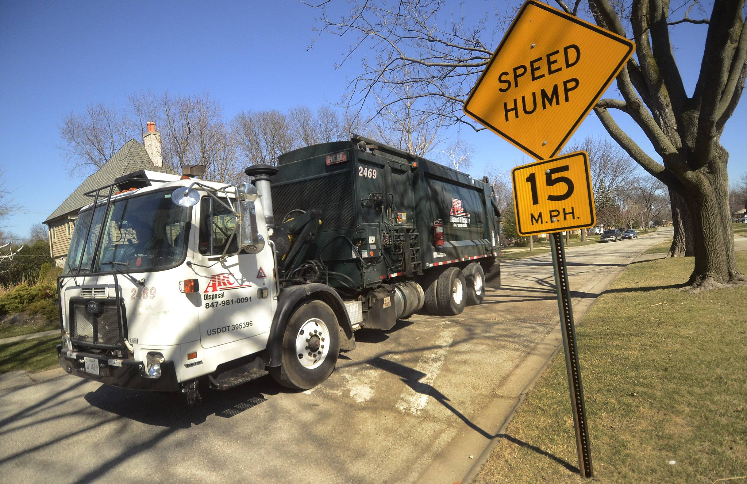 An ARC Disposal truck slows down for a speed hump on South See Gwun Avenue in Mount Prospect.
