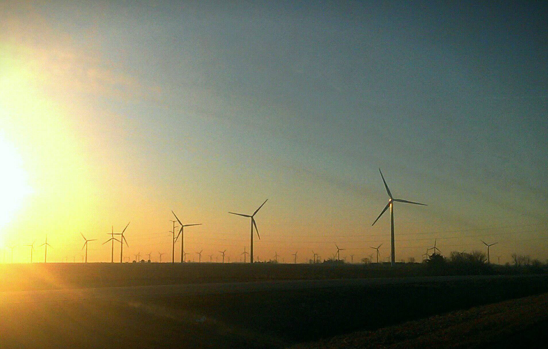 Took this photo on our way to Purdue University on a March morning.  The sun had just come over the horizon as if to announce that the renewable energy is here to stay.
