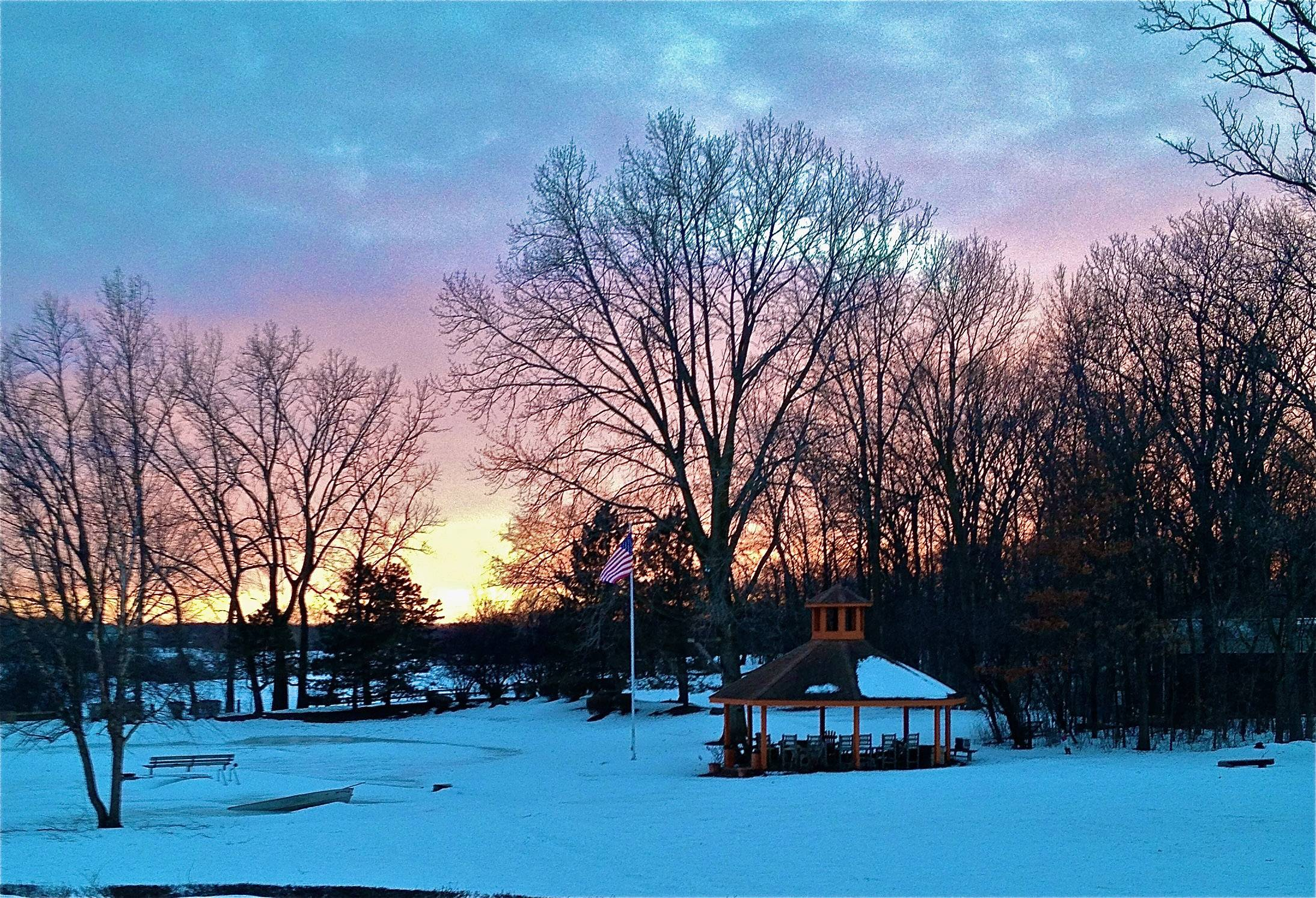 The sun sets over a park in Libertyville on a cold March evening.