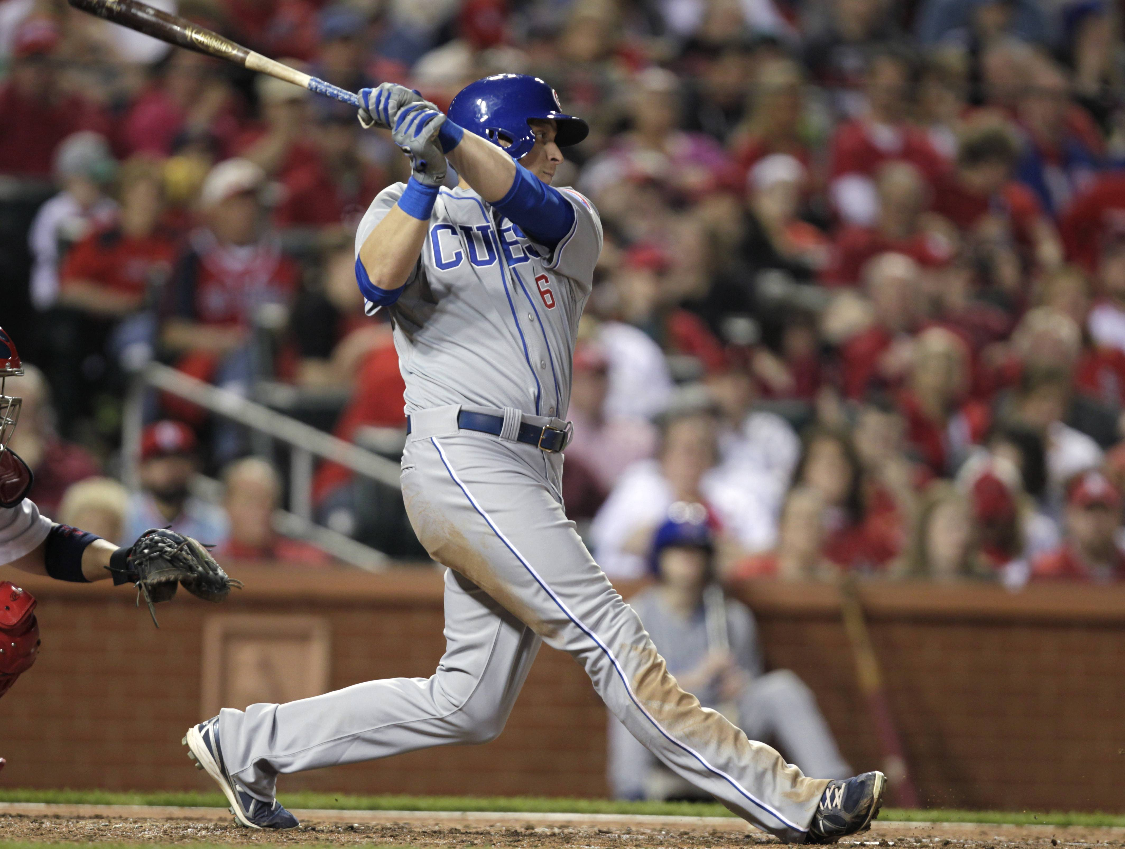 Chicago Cubs' Ryan Sweeney follows through on an RBI single in the seventh inning of a baseball game against the St. Louis Cardinals, Friday, April 11, 2014, in St. Louis.