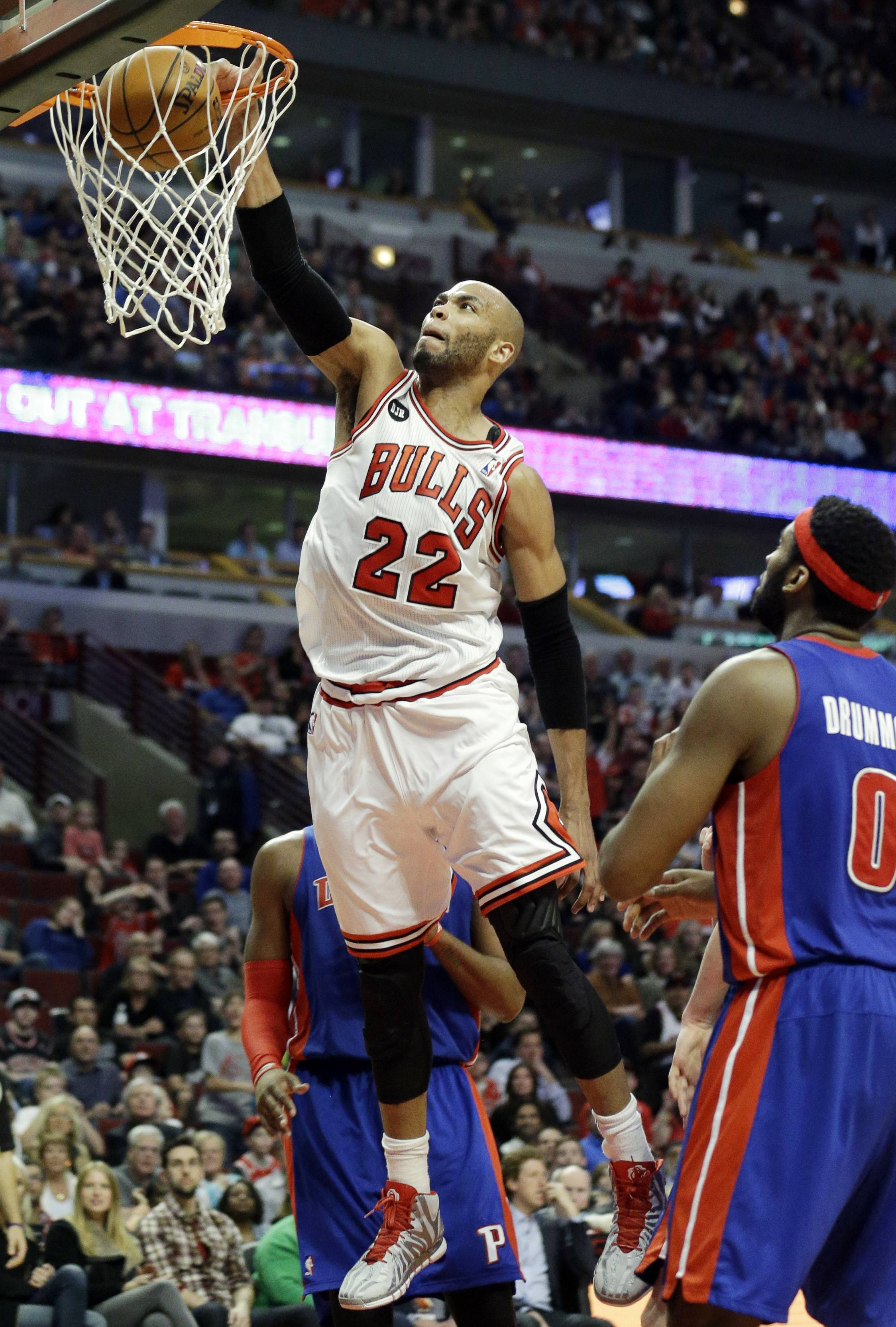 Chicago Bulls forward Taj Gibson (22) dunks against the during the second half of an NBA basketball game against the Detroit Pistons in Chicago on Friday, April 11, 2014. The Bulls won 106-98.