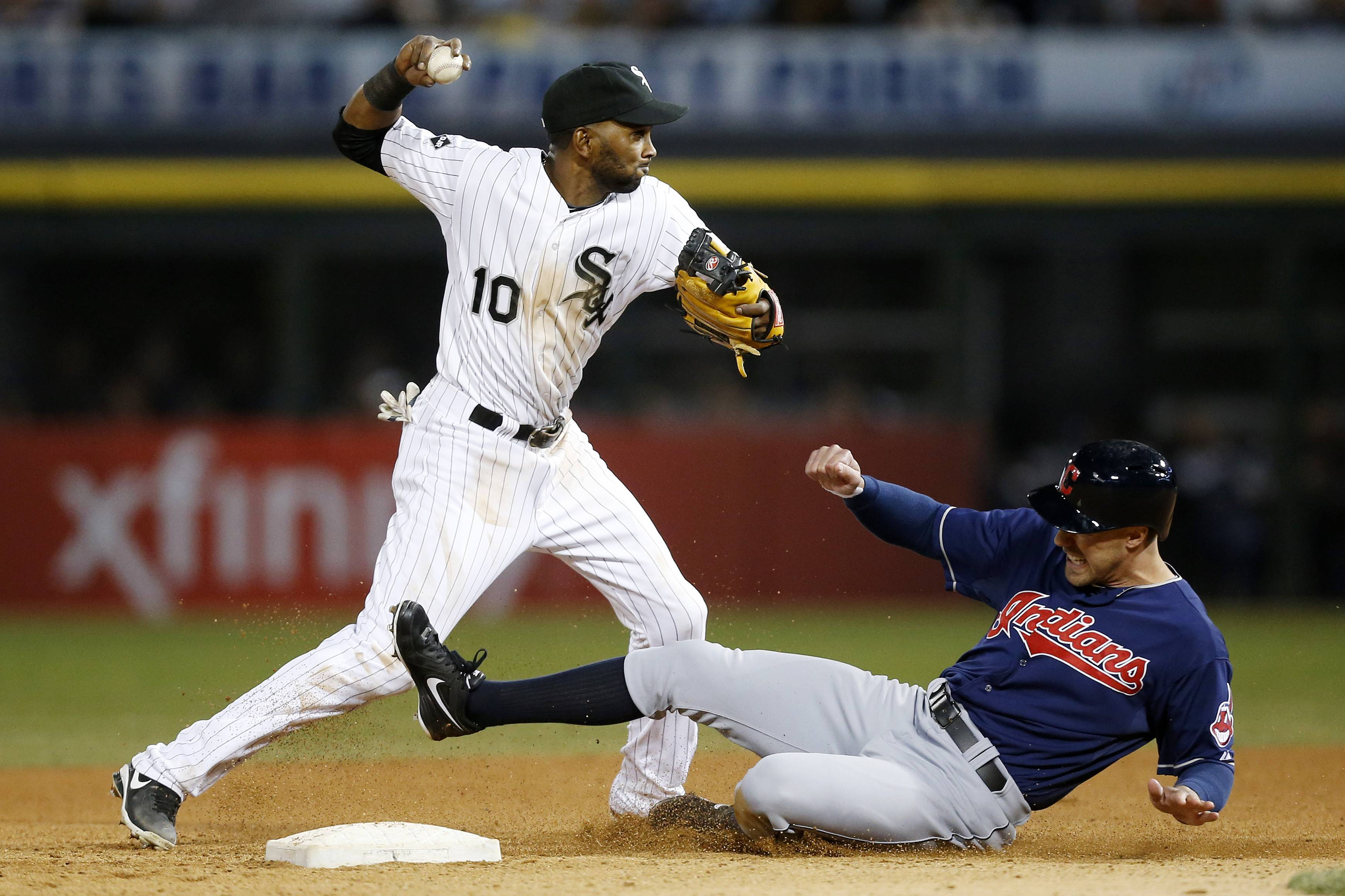 Chicago White Sox shortstop Alexei Ramirez forces out Cleveland Indians' David Murphy on a double play during the eighth inning of a baseball game on Friday, April 11, 2014, in Chicago. The White Sox won 9-6.