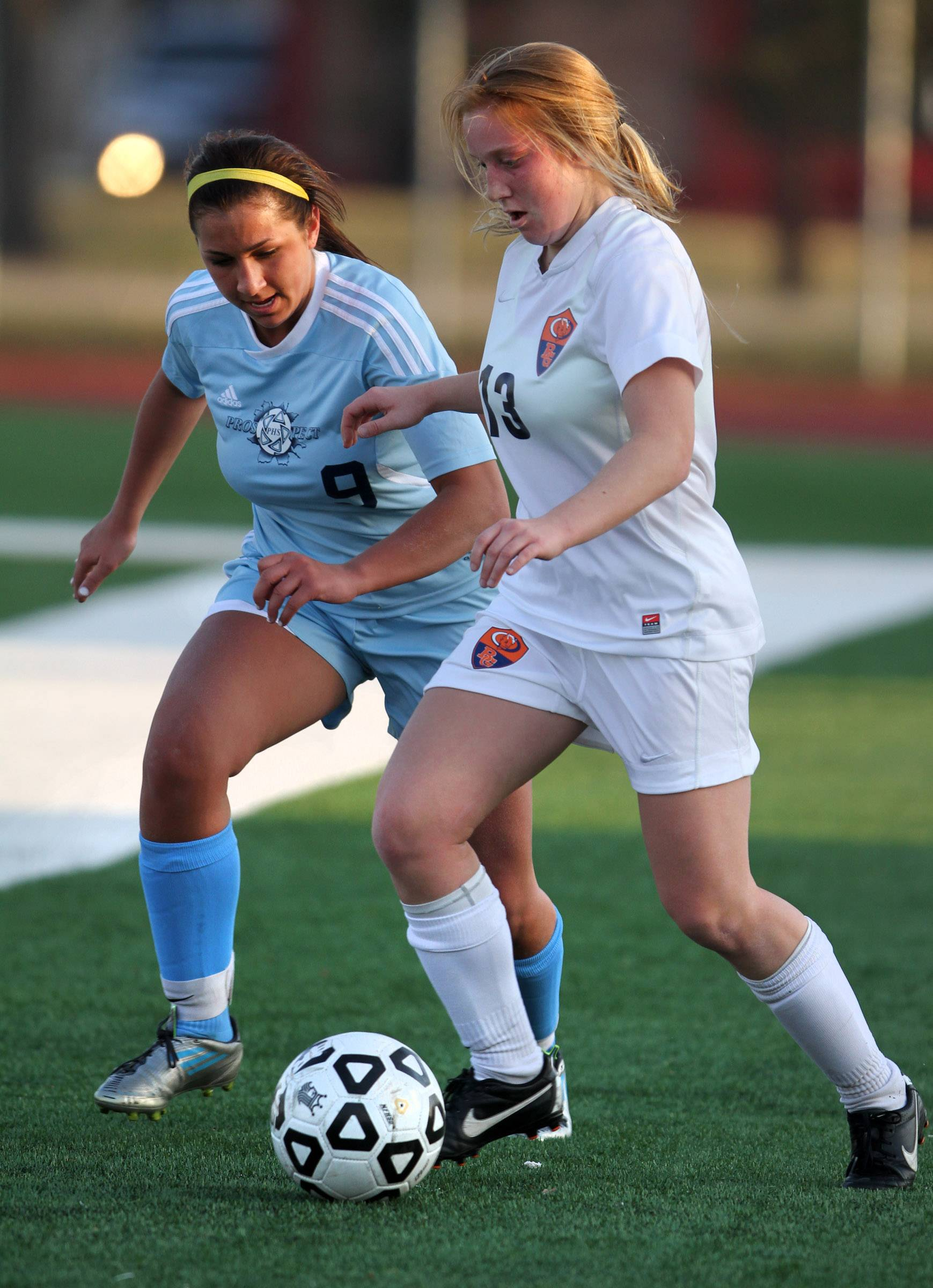 Buffalo Grove forward Kelli Zickert, right, dibbles the ball past Prospect defender Kristen Frasco on Friday at Buffalo Grove.