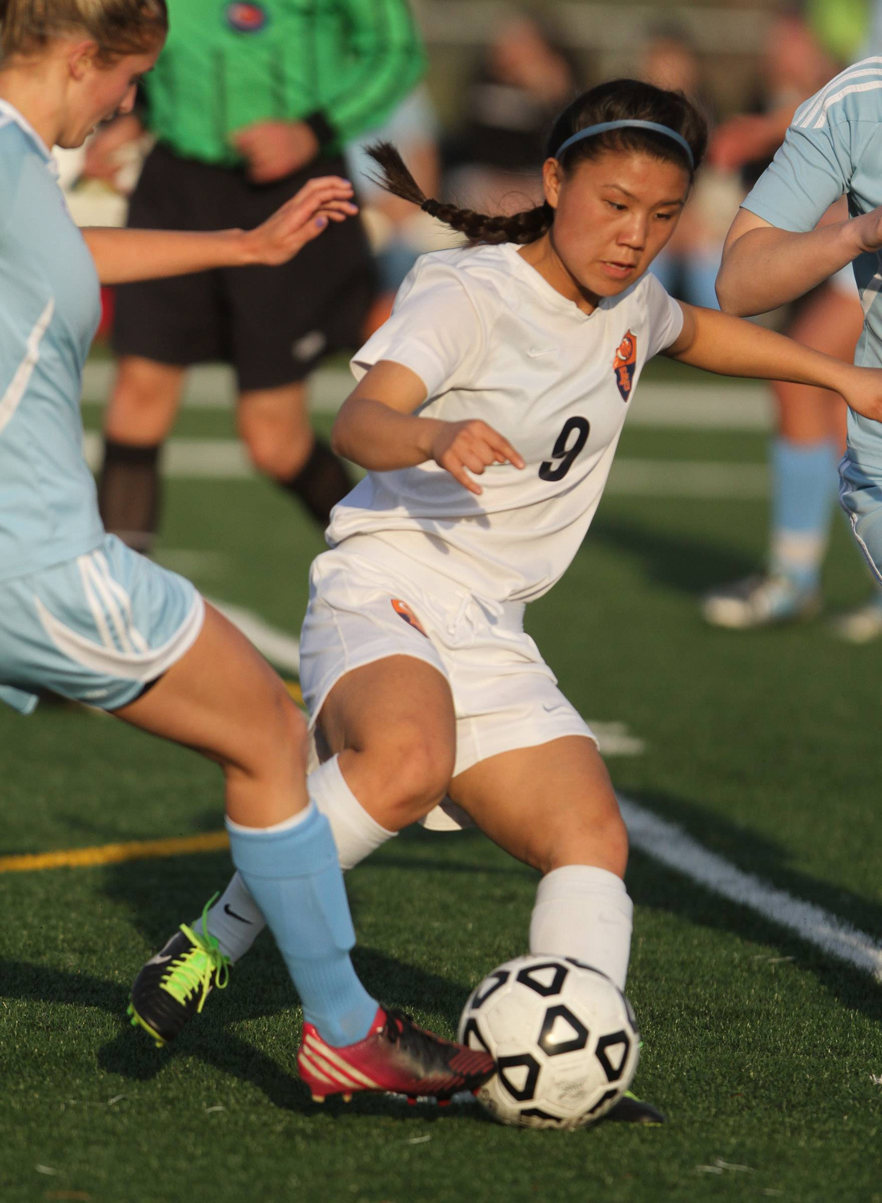Buffalo Grove midfielder Skylar Groth dibbles the ball past Prospect on Friday at Buffalo Grove.