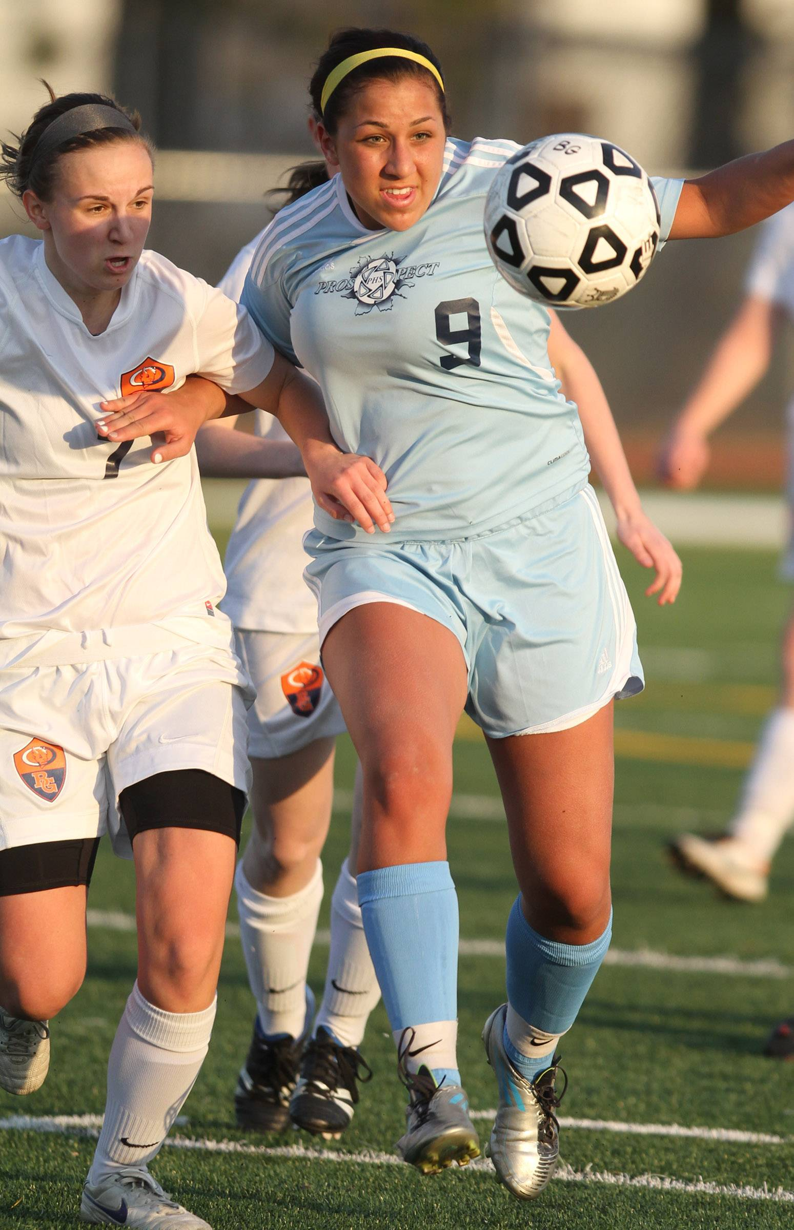 Buffalo Grove midfielder Jessica Kovach, left,  tries to get ahead of Prospect defender Kristen Frasco on Friday at Buffalo Grove.