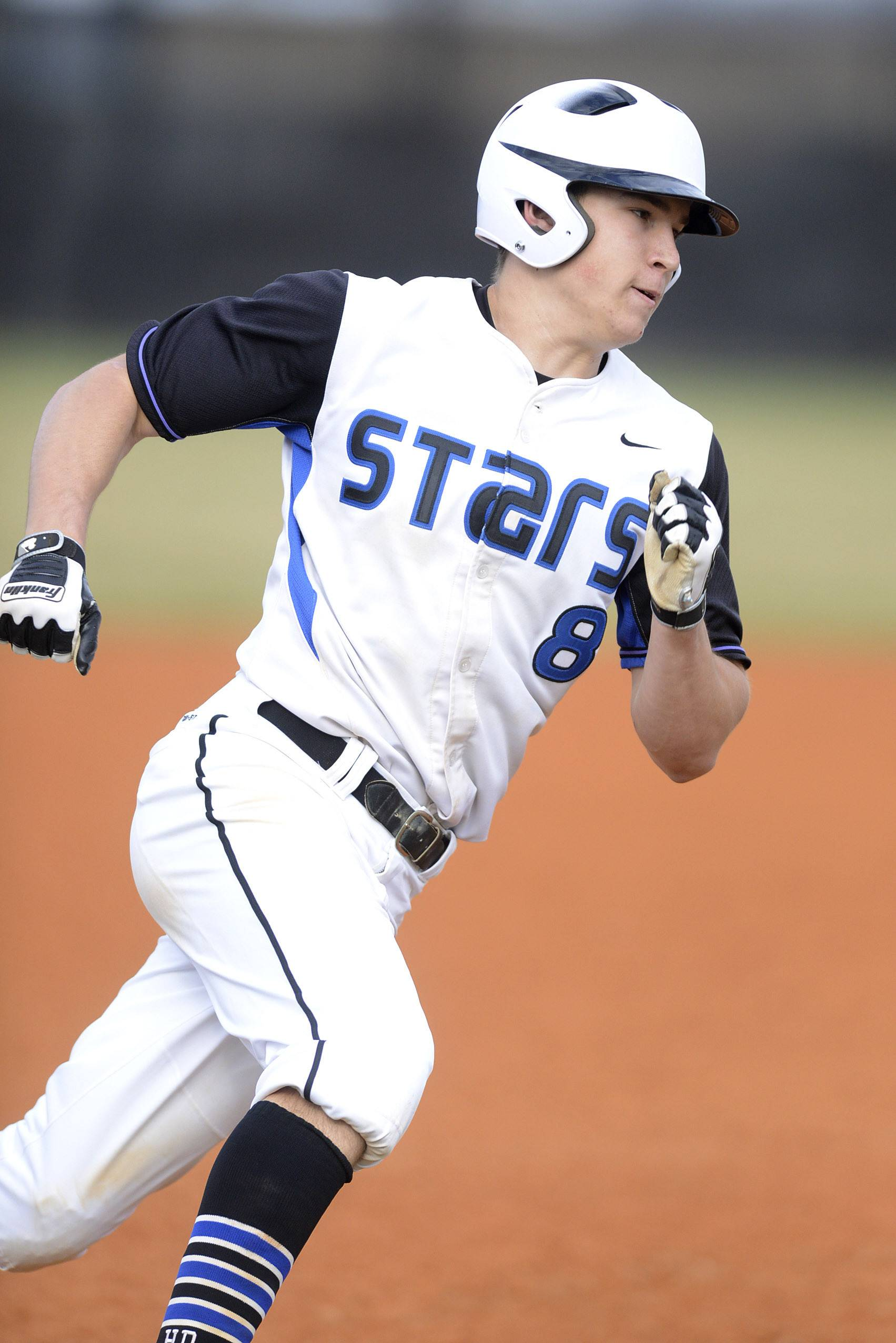 St. Charles North's Nick Drawant rounds third base on Friday, April 11.