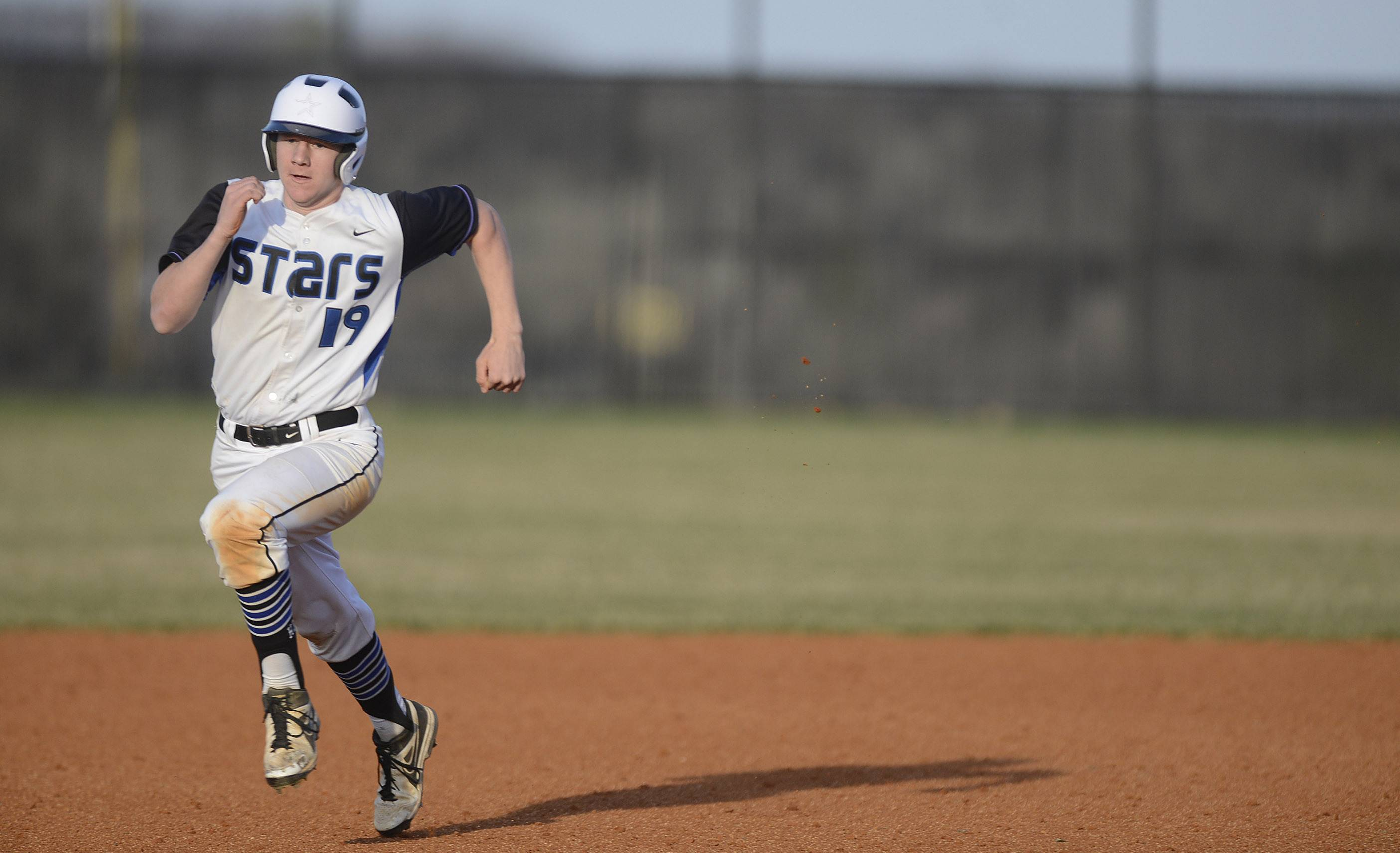 St. Charles North's Tim Hausl sprints from second base to third base in the fifth inning on Friday, April 11.