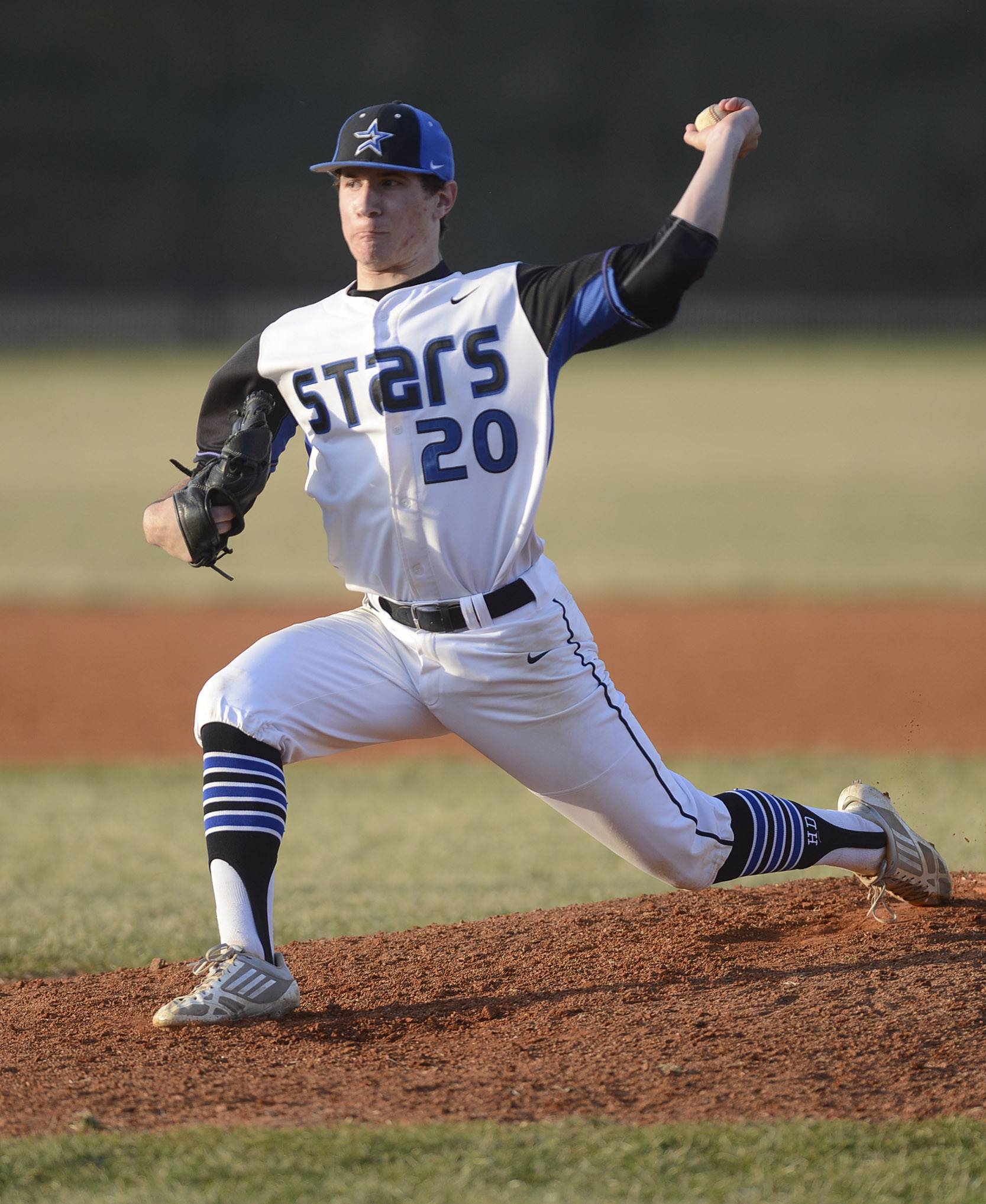 St. Charles North's Cory Wright pitches on Friday, April 11.