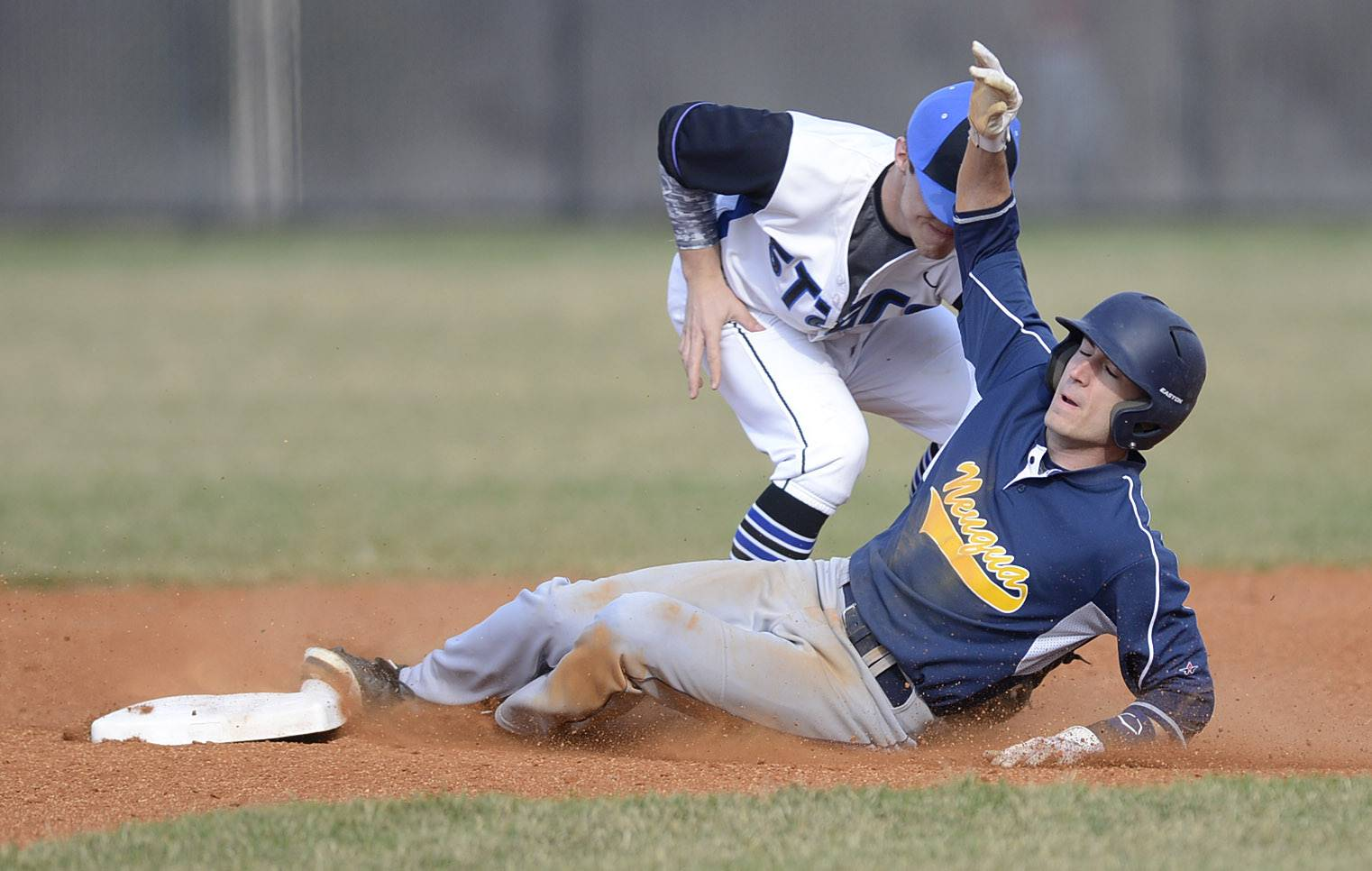 St. Charles North's Zach Mettetal tags out Neuqua Valley's Josh Piotrowski at second base in the first inning on Friday, April 11.