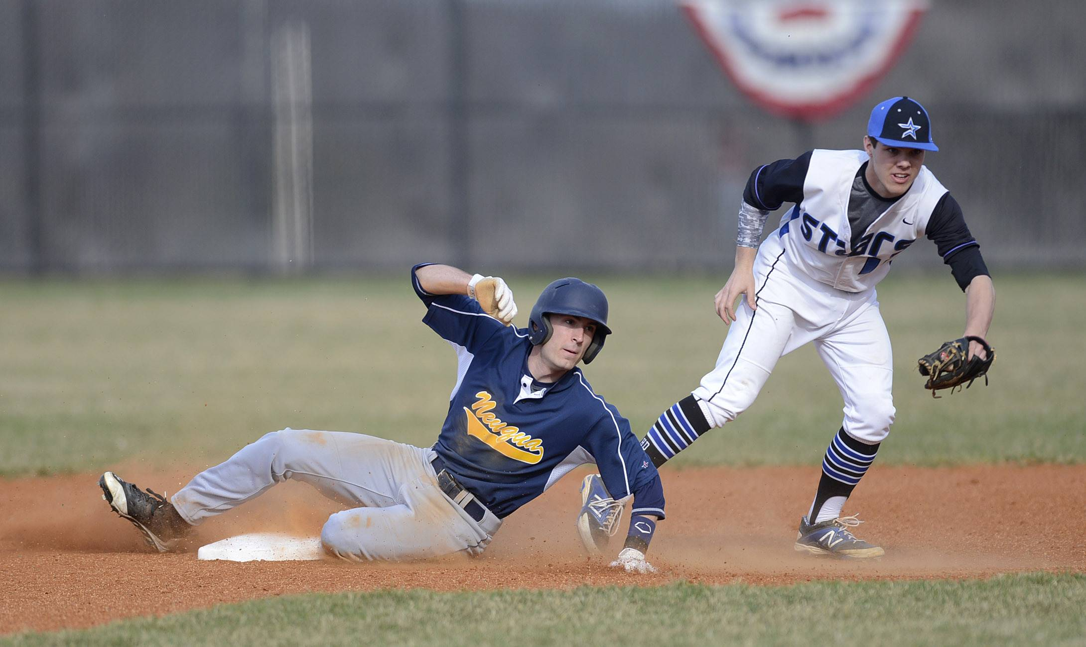 Neuqua Valley's Josh Piotrowski is out at second base by St. Charles North's Zach Mettetal in the first inning on Friday, April 11.