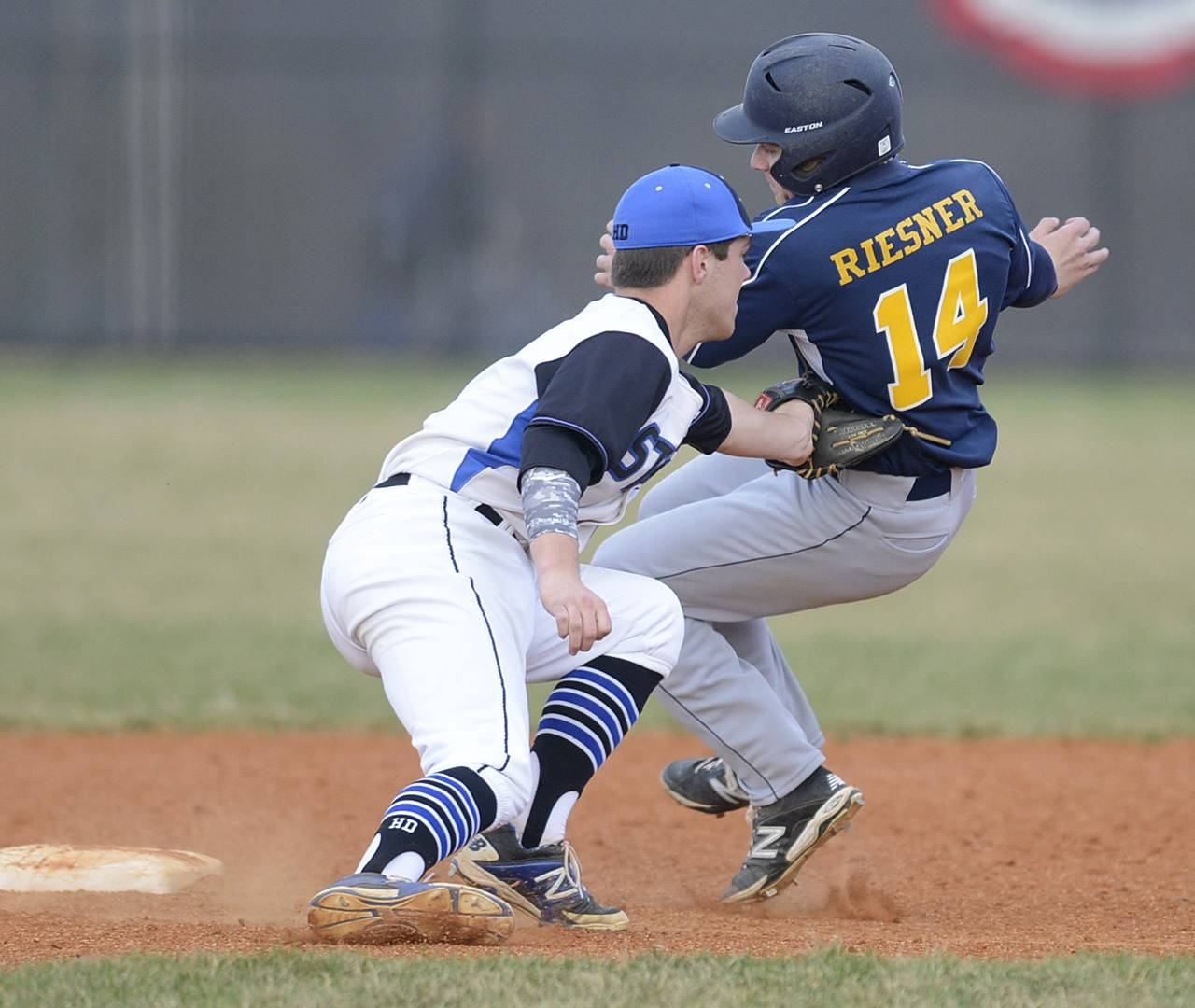 St. Charles North's Zach Mettetal tags out Neuqua Valley's Mike Riesner at second base in the second inning on Friday, April 11.