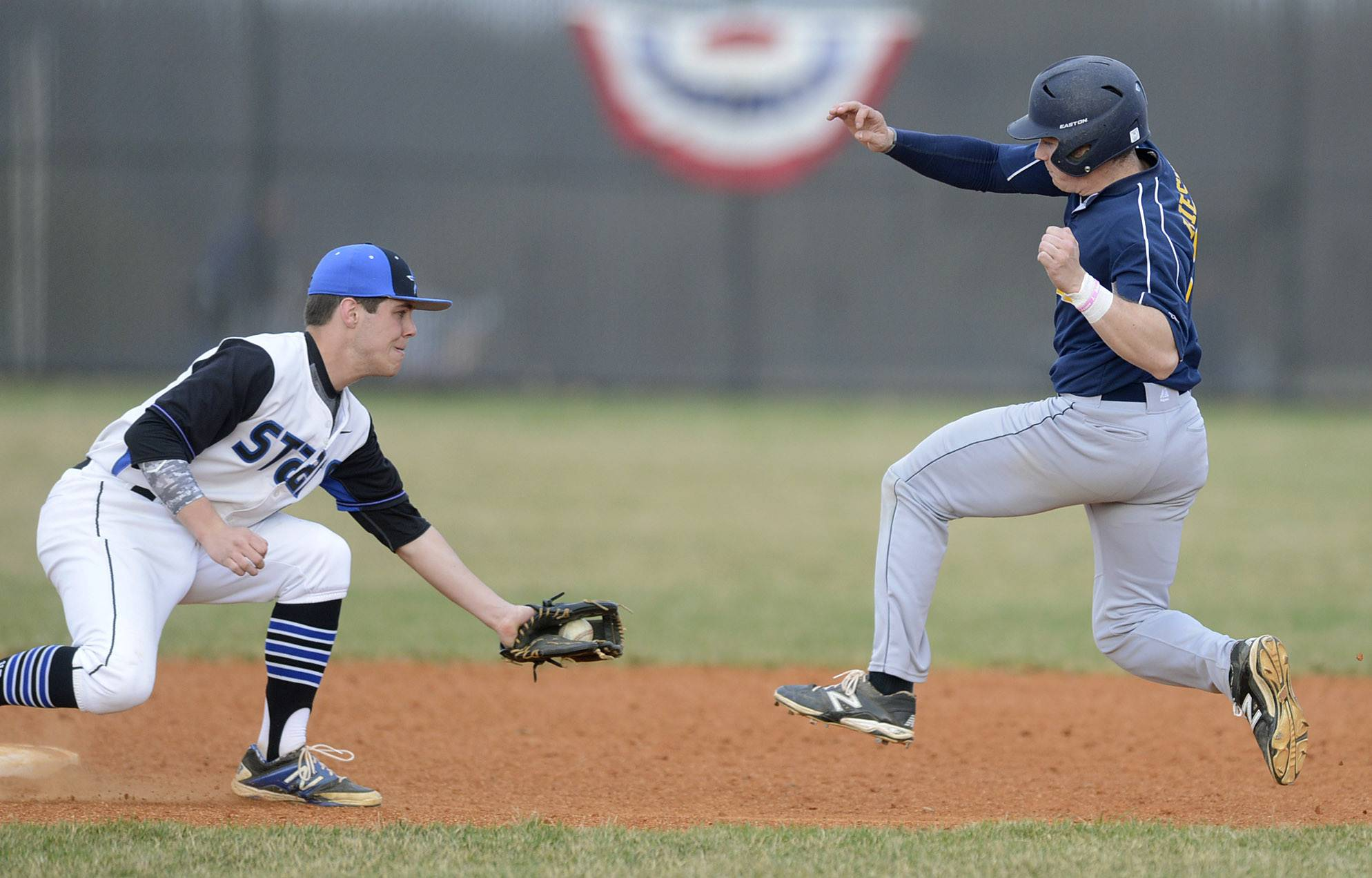 St. Charles North's Zach Mettetal has Neuqua Valley's Mike Riesner out at second base before he reaches the base in the second inning on Friday, April 11.