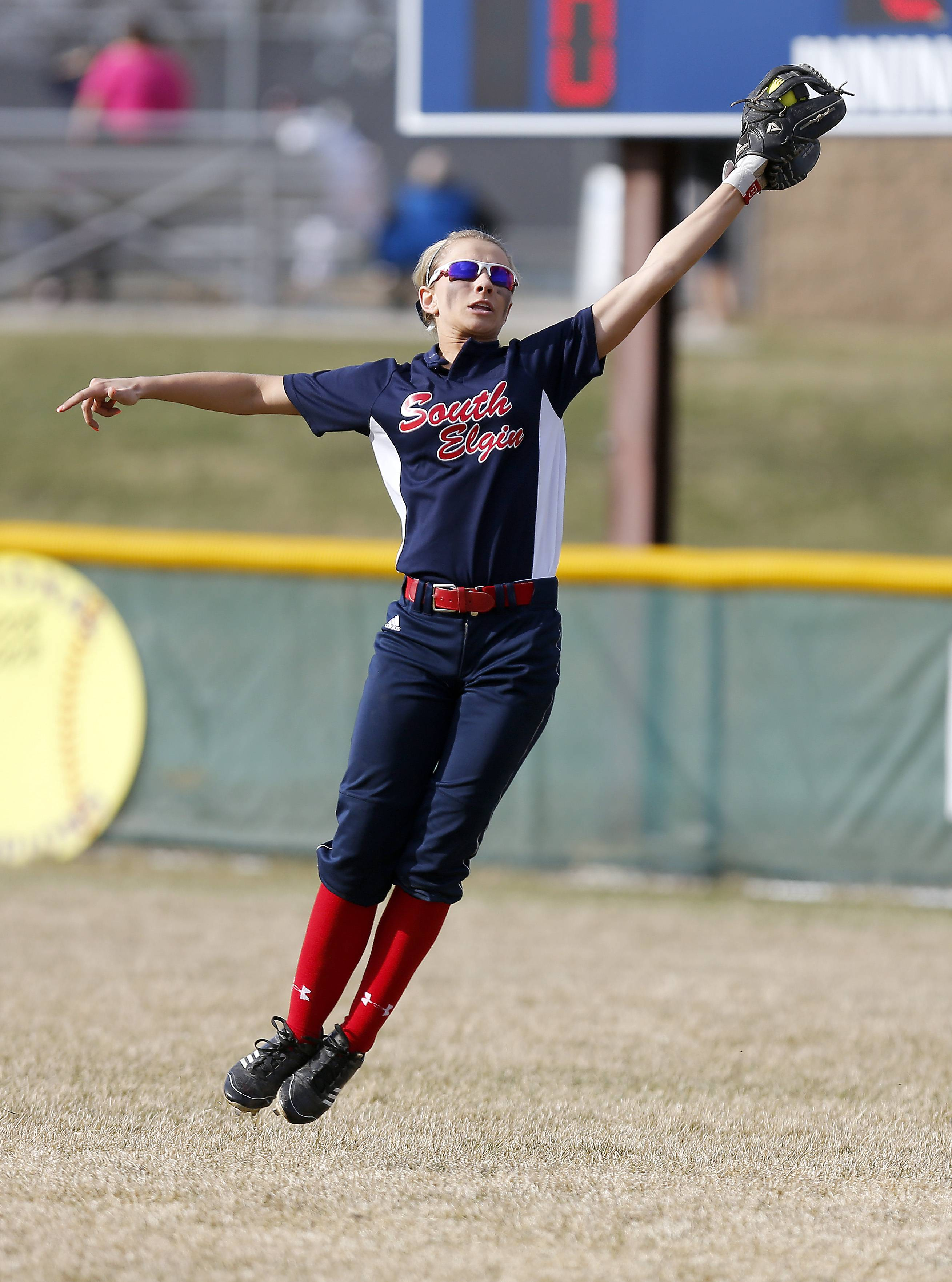 South Elgin's Mallory Mecklenburg grabs a shot by St. Charles North's Sabrina Rabin to close out the second inning Friday at South Elgin.