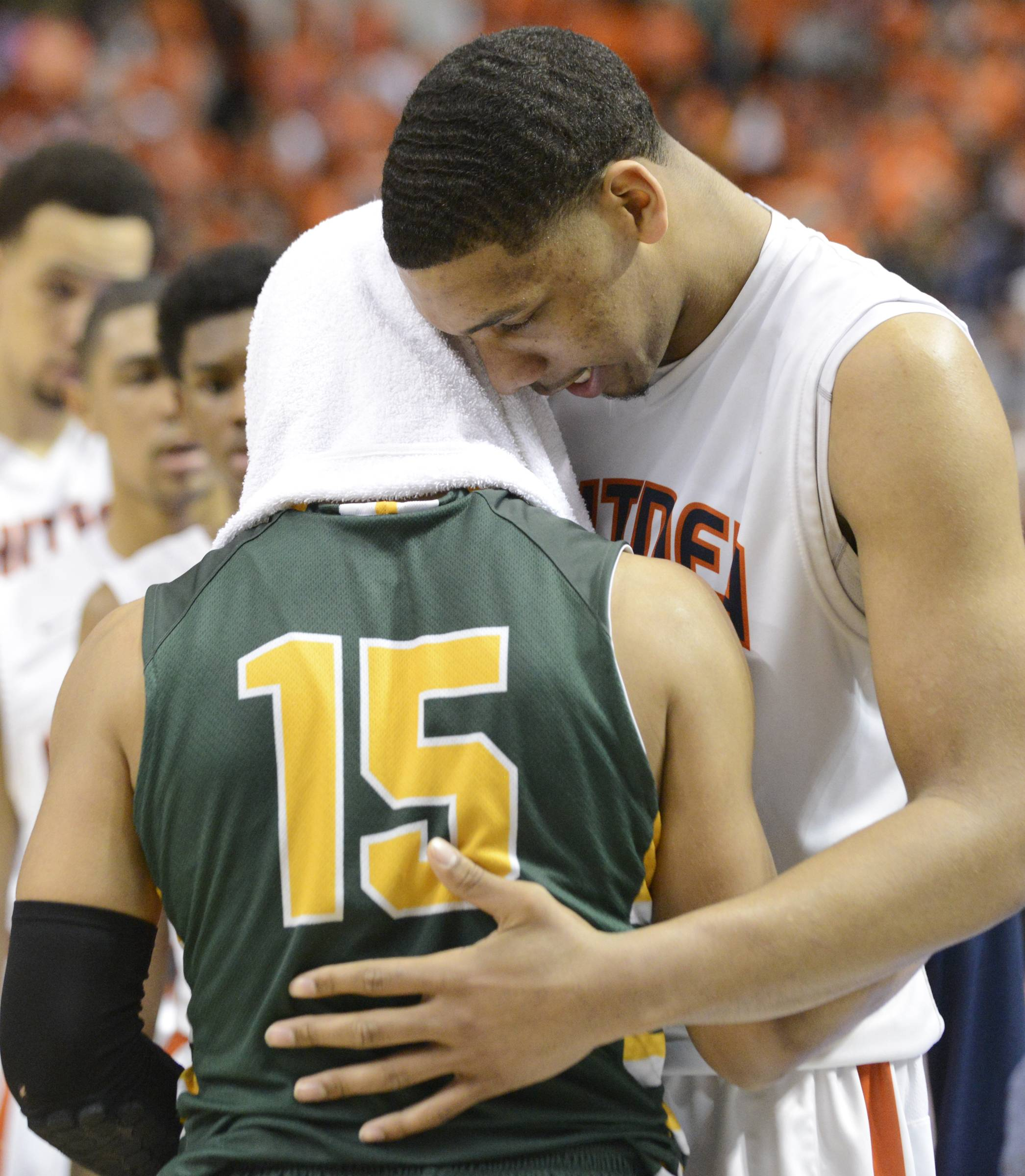 Stevenson's Jalen Brunson and Whitney Young's Jahlil Okafor, right, talk after Whitney Young's victory in the Class 4A state semifinal at Carver Arena in Peoria. Okafor, the No. 1 player in the nation, will play for Duke next season.