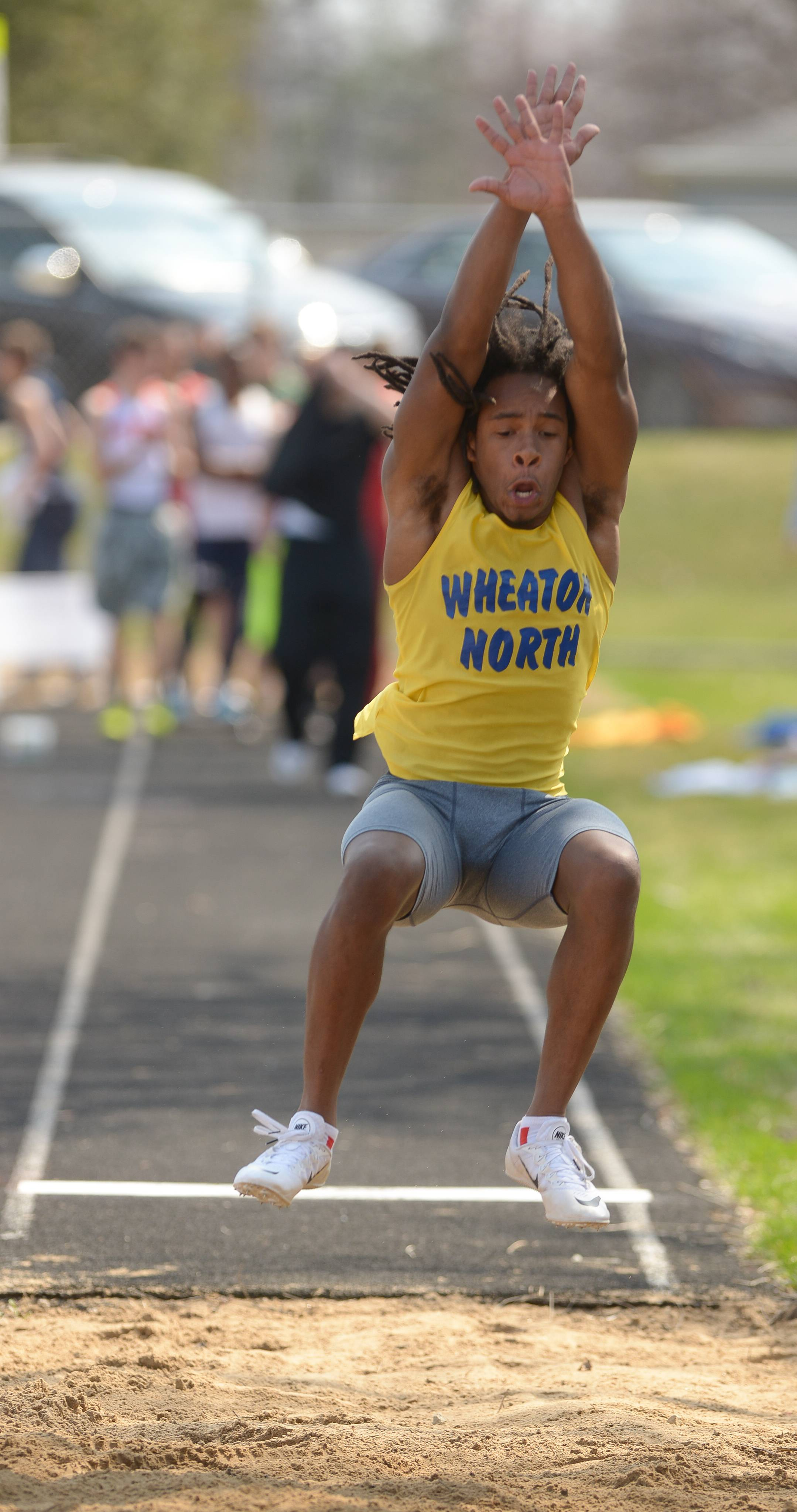 Mark Black/mblack@dailyherald.com Wheaton North's Chico Jackson competes in the Long Jump during Wheaton North's 29th Annual Best 4 Invite.