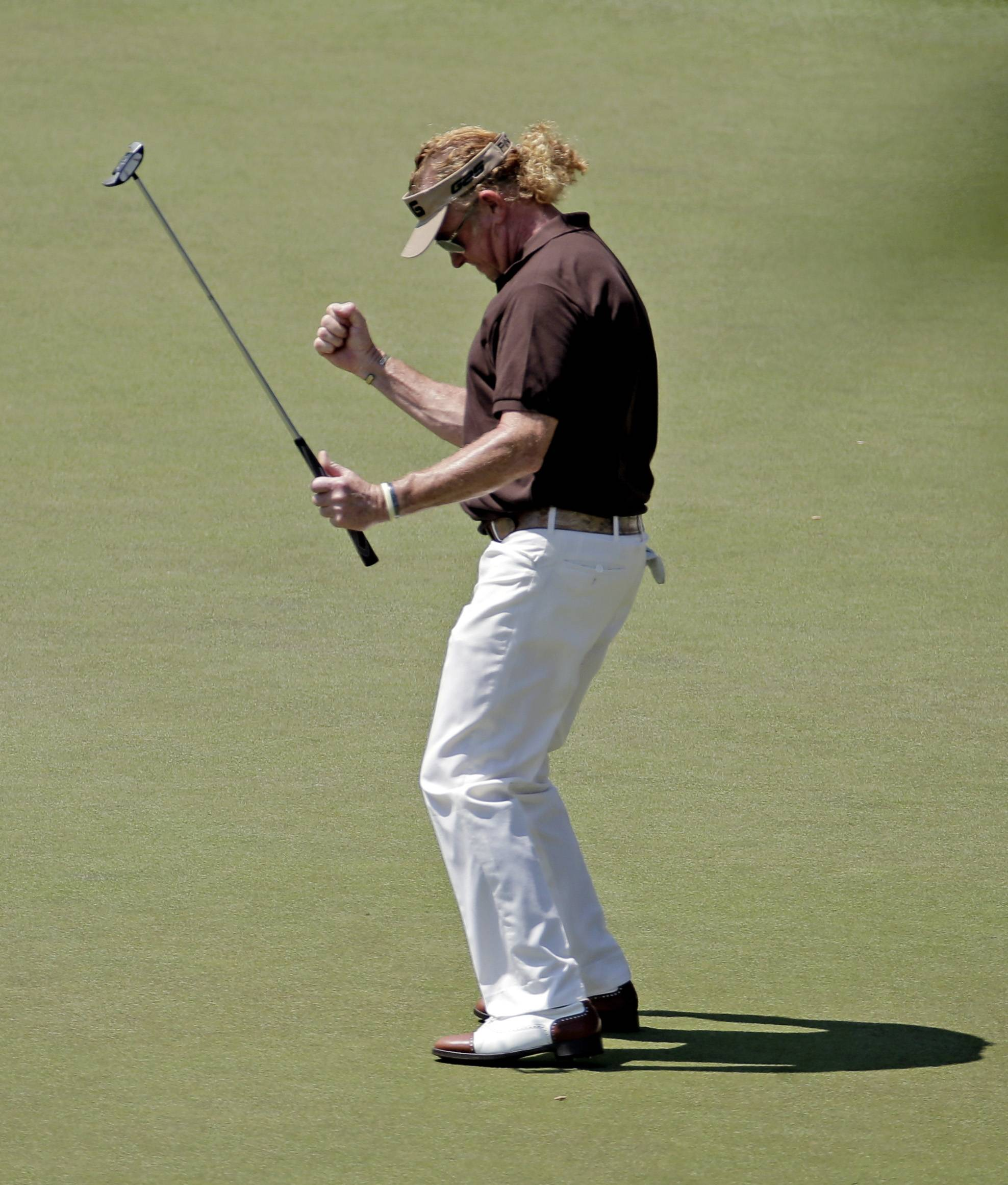 Miguel Angel Jimenez, of Spain, pumps his fist after a birdie on the 16th hole during the third round of the Masters golf tournament Saturday, April 12, 2014, in Augusta, Ga. (AP Photo/Charlie Riedel)