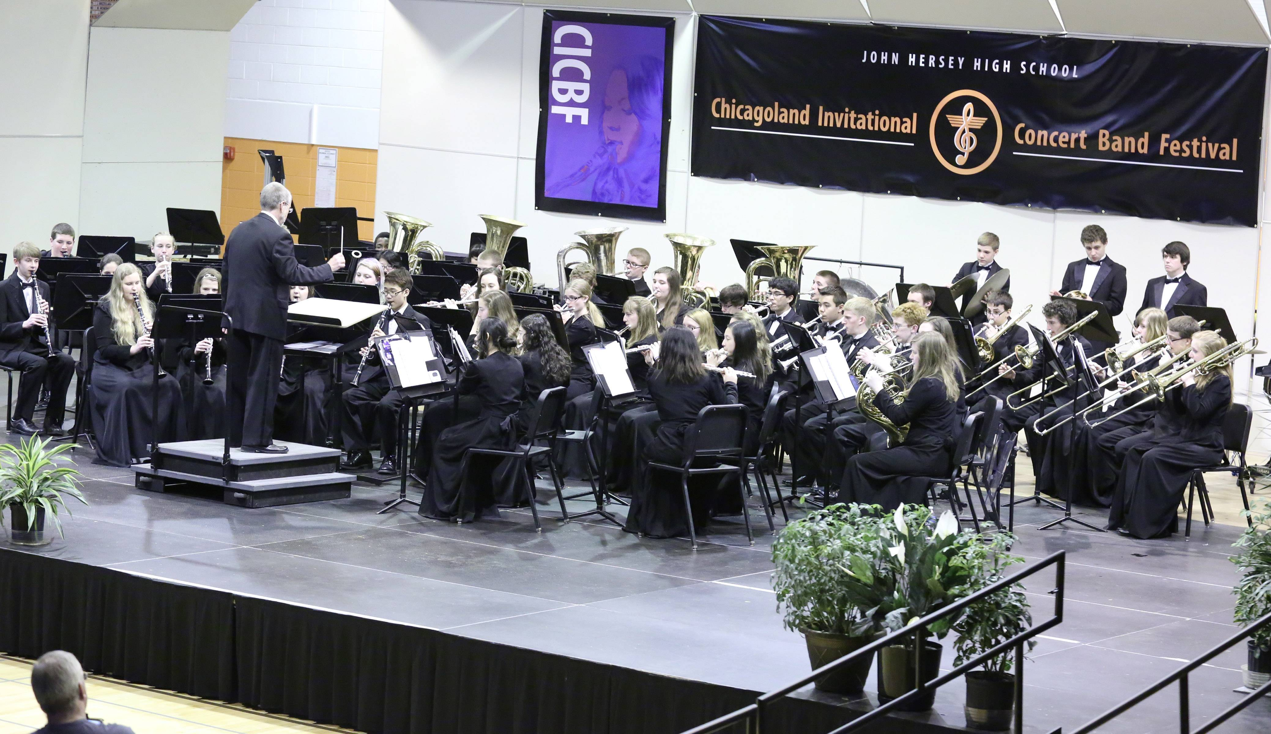 The John Hersey High School Concert Band, conducted by Tom Beckwith, takes the stage at the 14th Annual Chicagoland Invitational Concert Band Festival Saturday at the Arlington Heights school.