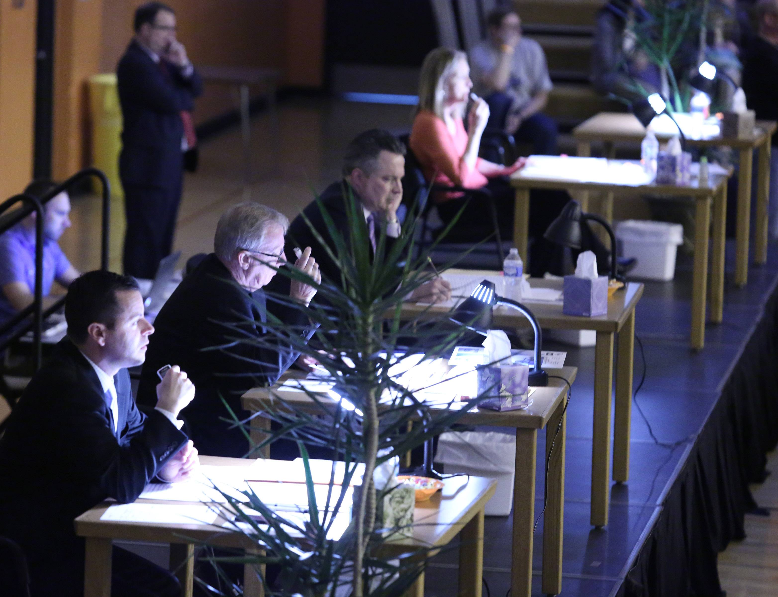 Judges take notes and use microphones to record scores Saturday during the 14th Annual Chicagoland Invitational.