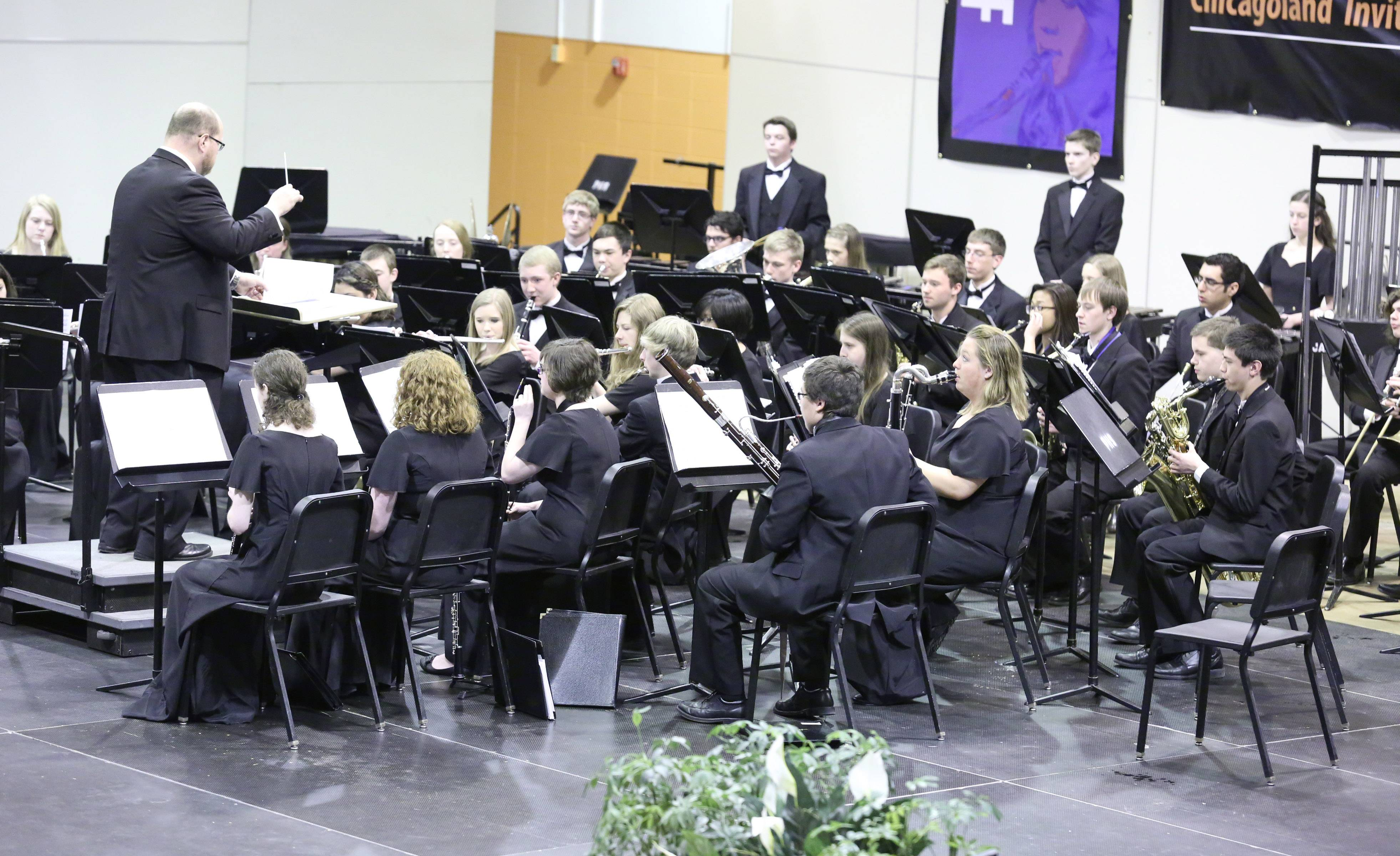 About 40 school bands from across the suburbs won an invitation to the concert, including Mundelein High School's wind ensemble.