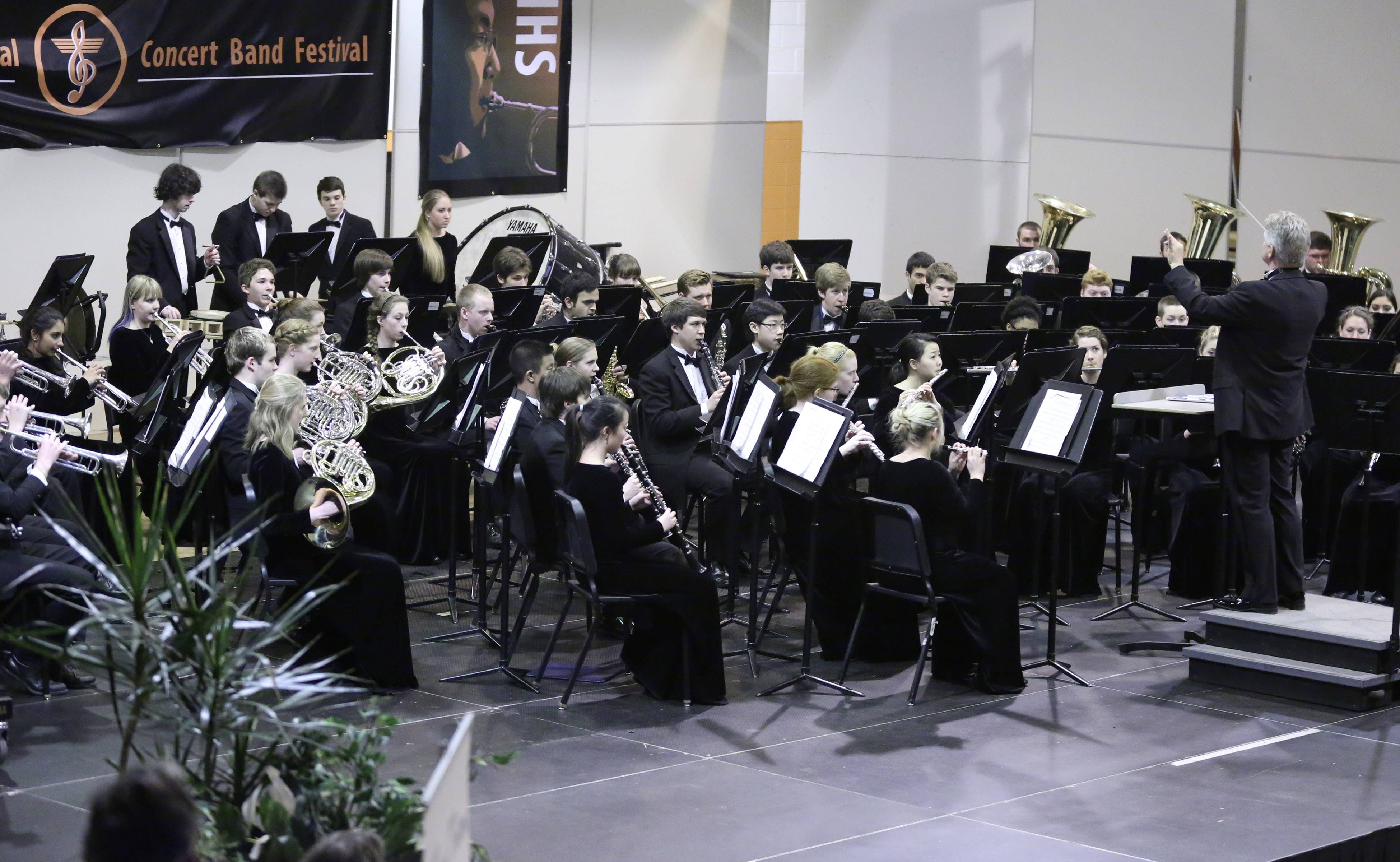 Naperville North Symphonic Wind Ensemble conducted by Daniel Moore performs at the 14th Annual Chicagoland Invitational at Hersey High School on Saturday in Arlington Heights.