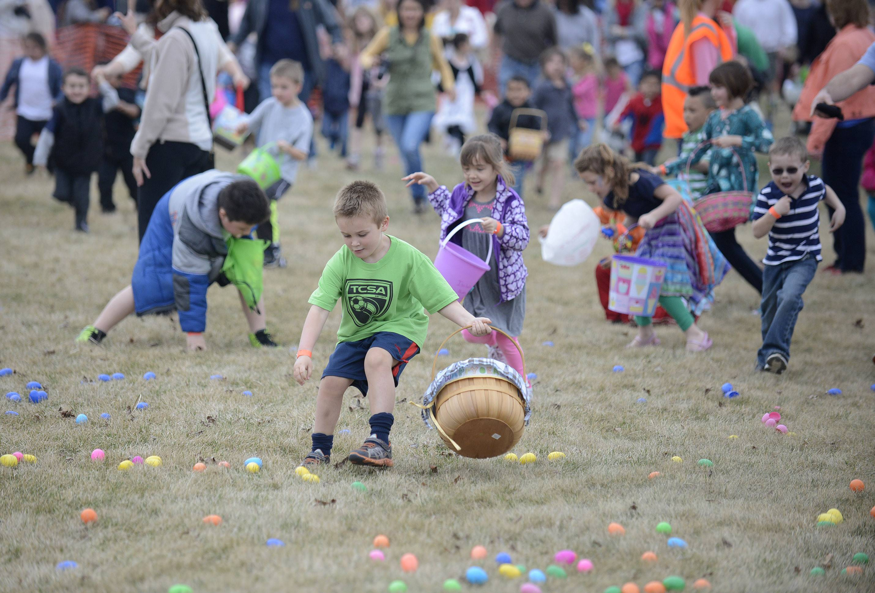 Kids take off running for the egg hunt Saturday at Faith Baptist Mill Creek Creek Church in Geneva.