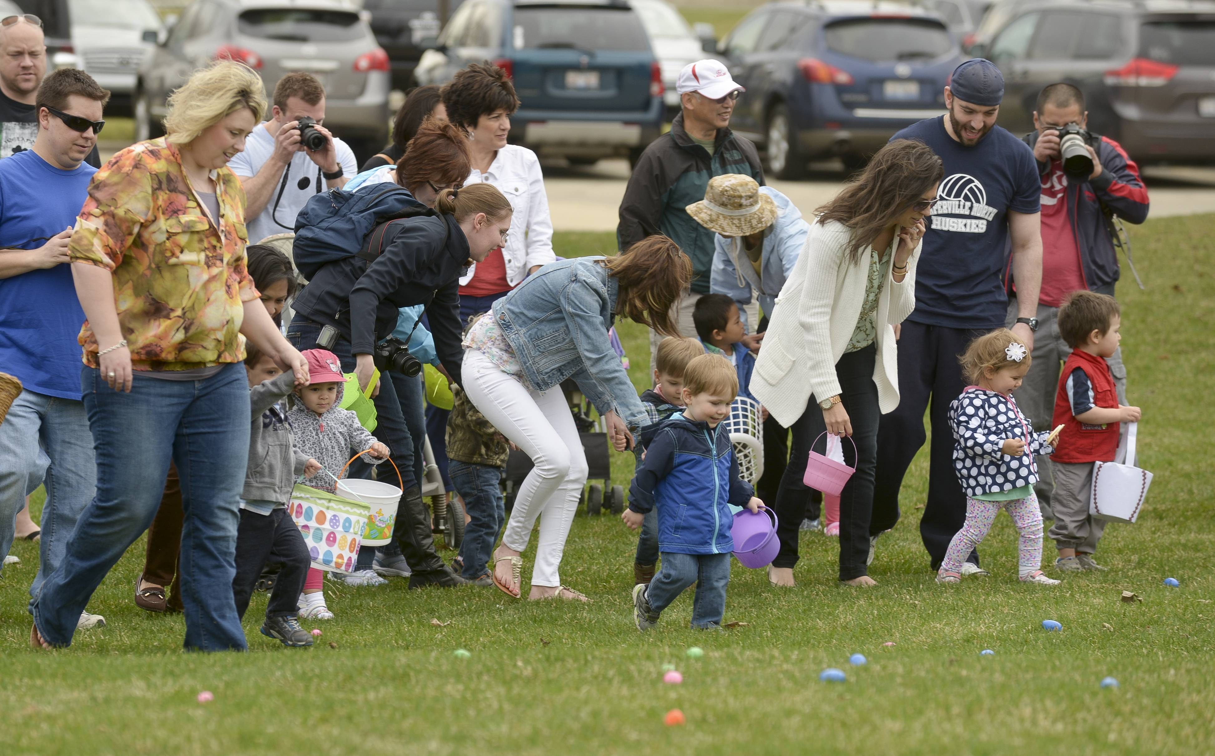 Children rush to gather up eggs during an Easter egg hunt Saturday at Lisle's Community Park,