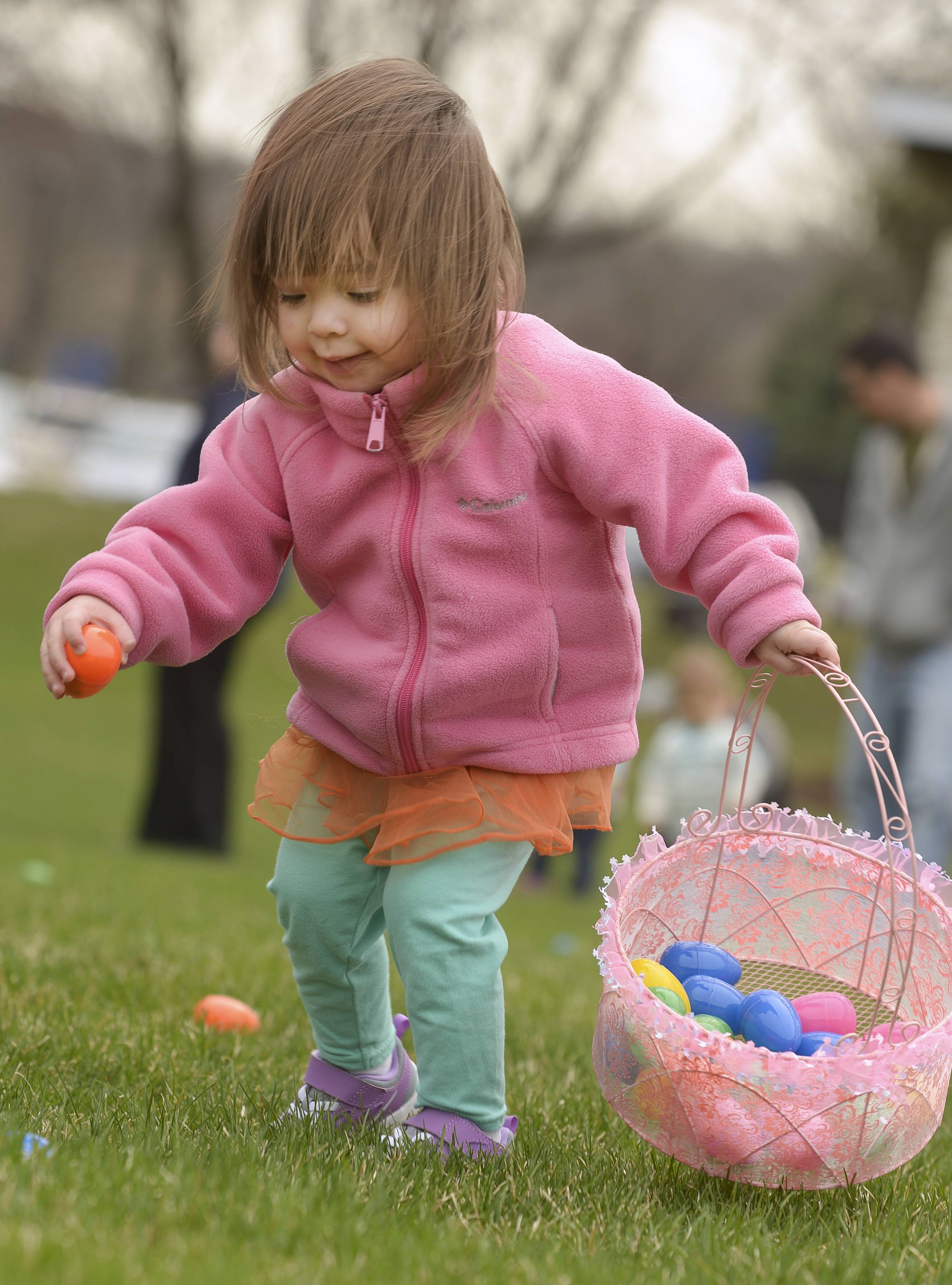 Emma Aguilar, 2, of Plainfield, runs to fill up her basket.