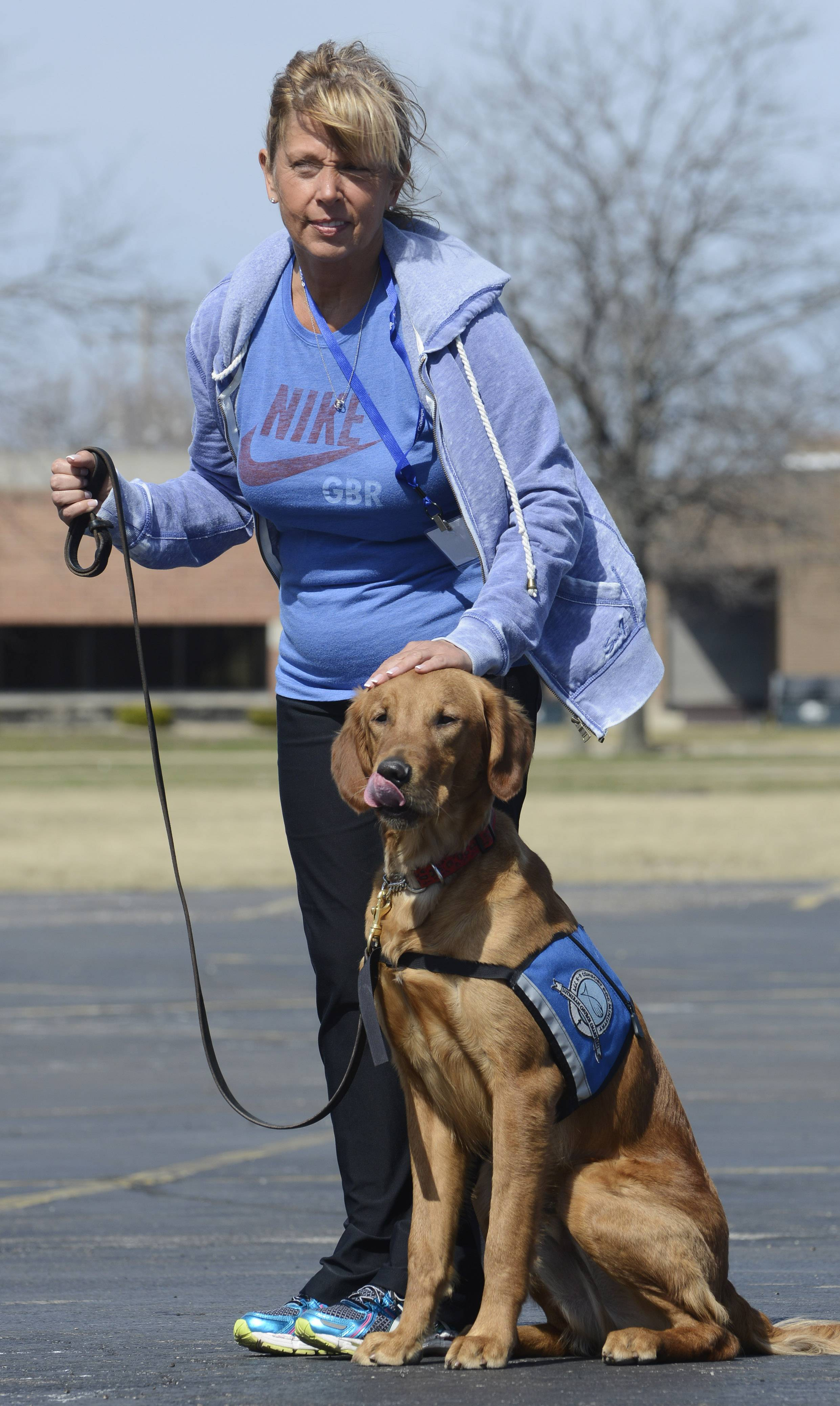 Linda Cecchi heaps praise on Martin, a newcomer to the comfort dog ranks.