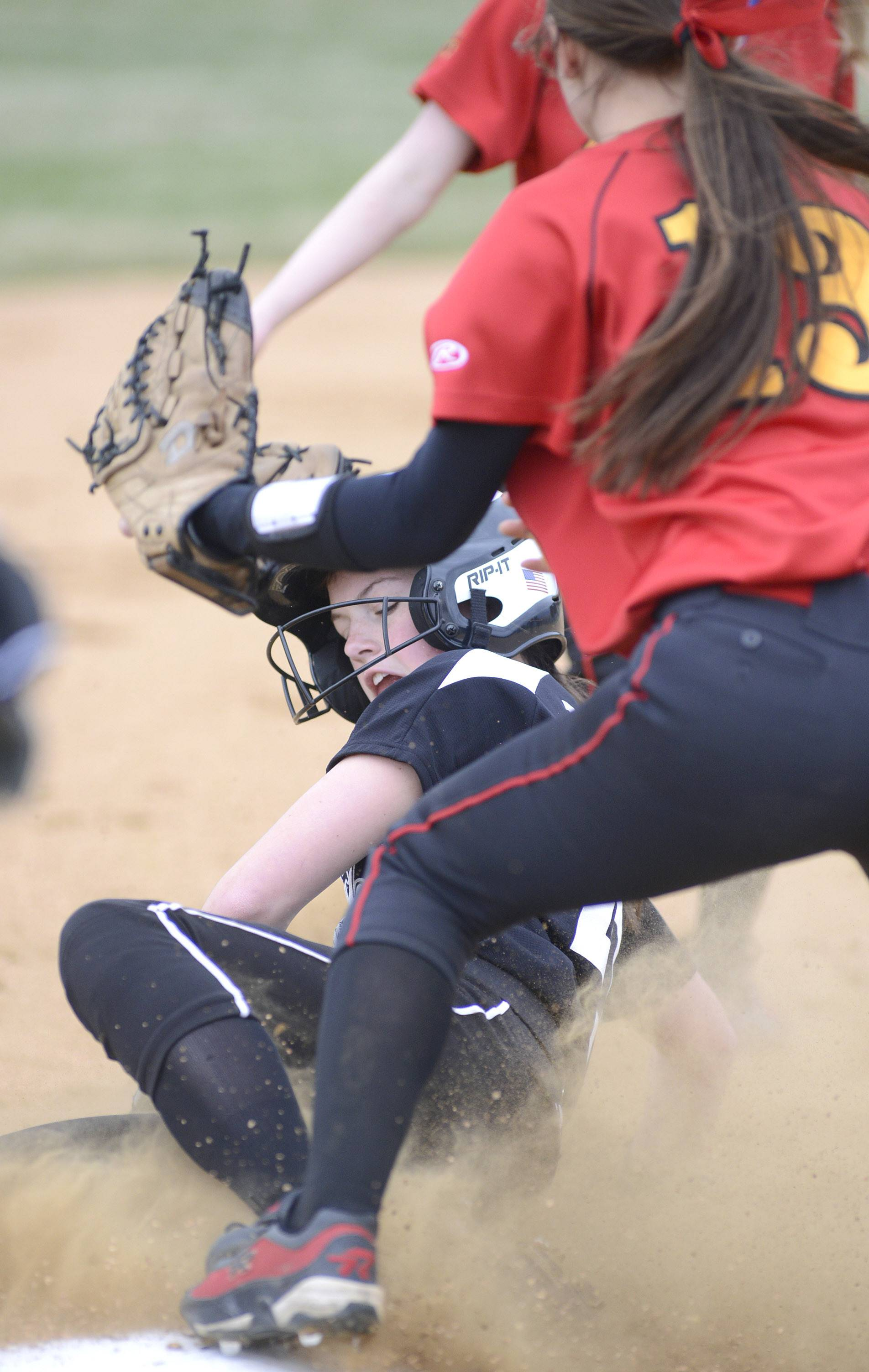 Kaneland's Morgan Weber is safe on third from Batavia's Nina Karius in the first inning on Saturday, April 12.