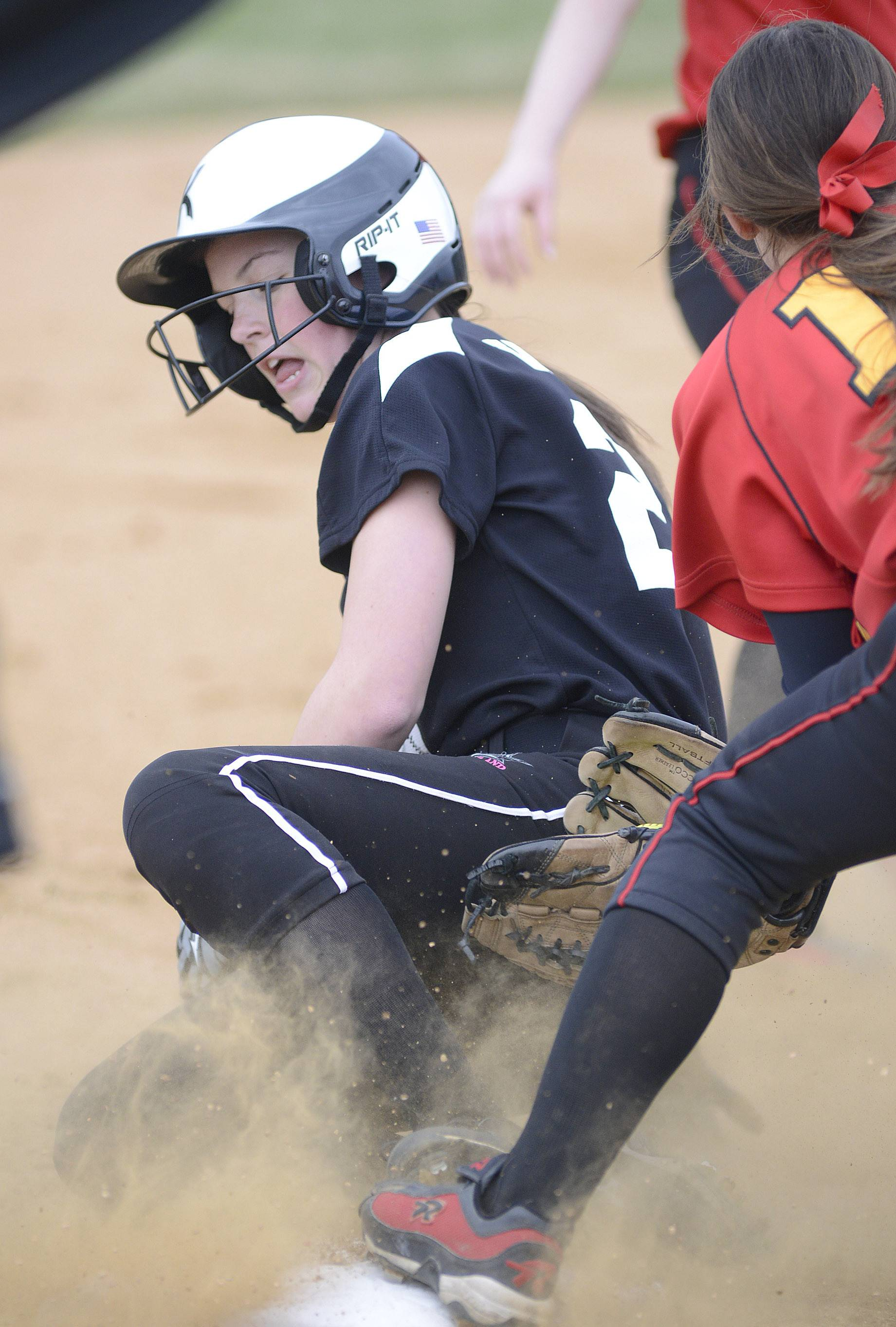 Kaneland's Morgan Weber is safe at third from Batavia's Nina Karius in the first inning on Saturday, April 12.