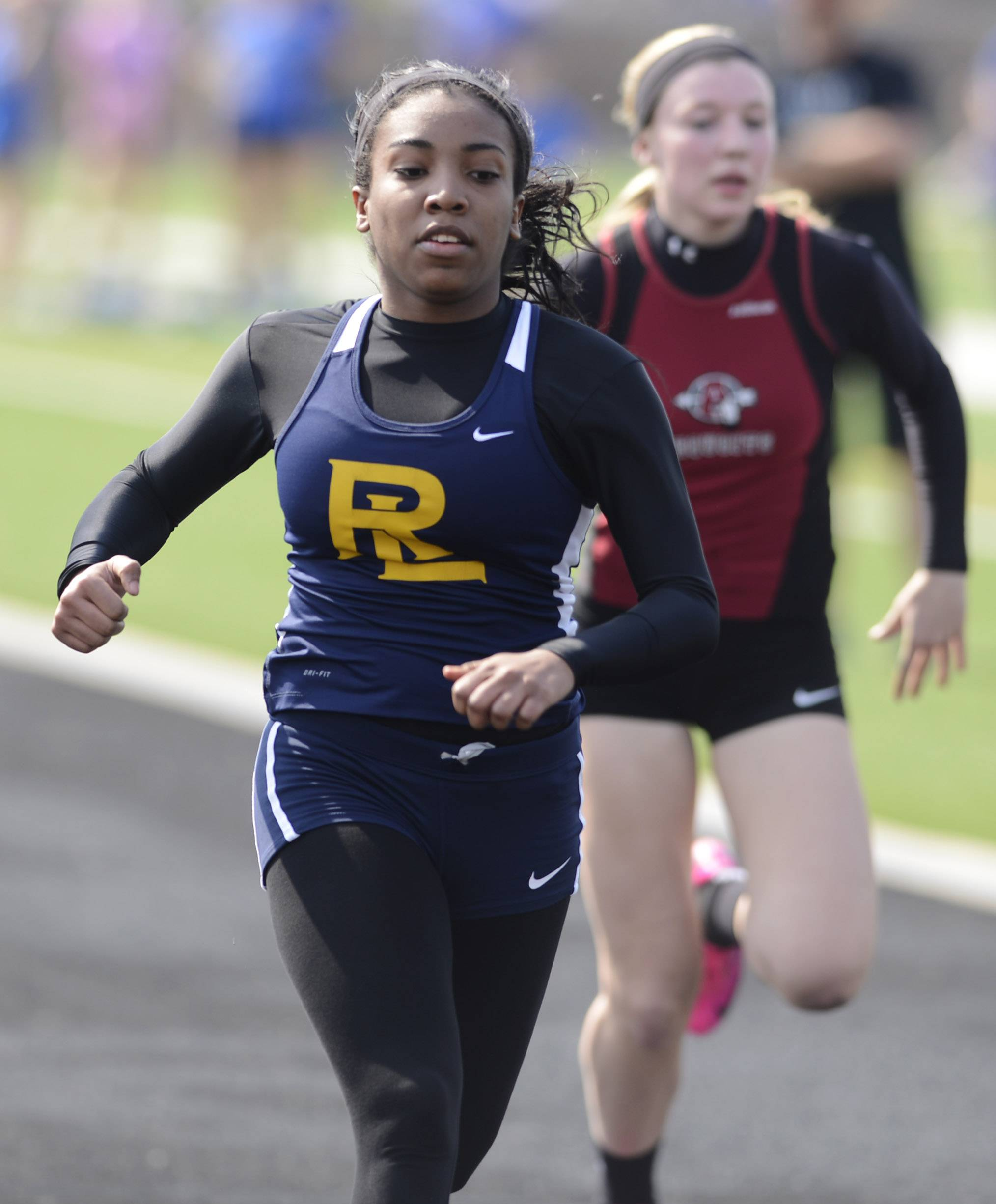Round Lake's Destiny Brown wins her heat during the semifinals of the 100-meter dash during Saturday's track meet in at Grant High School in Fox Lake.