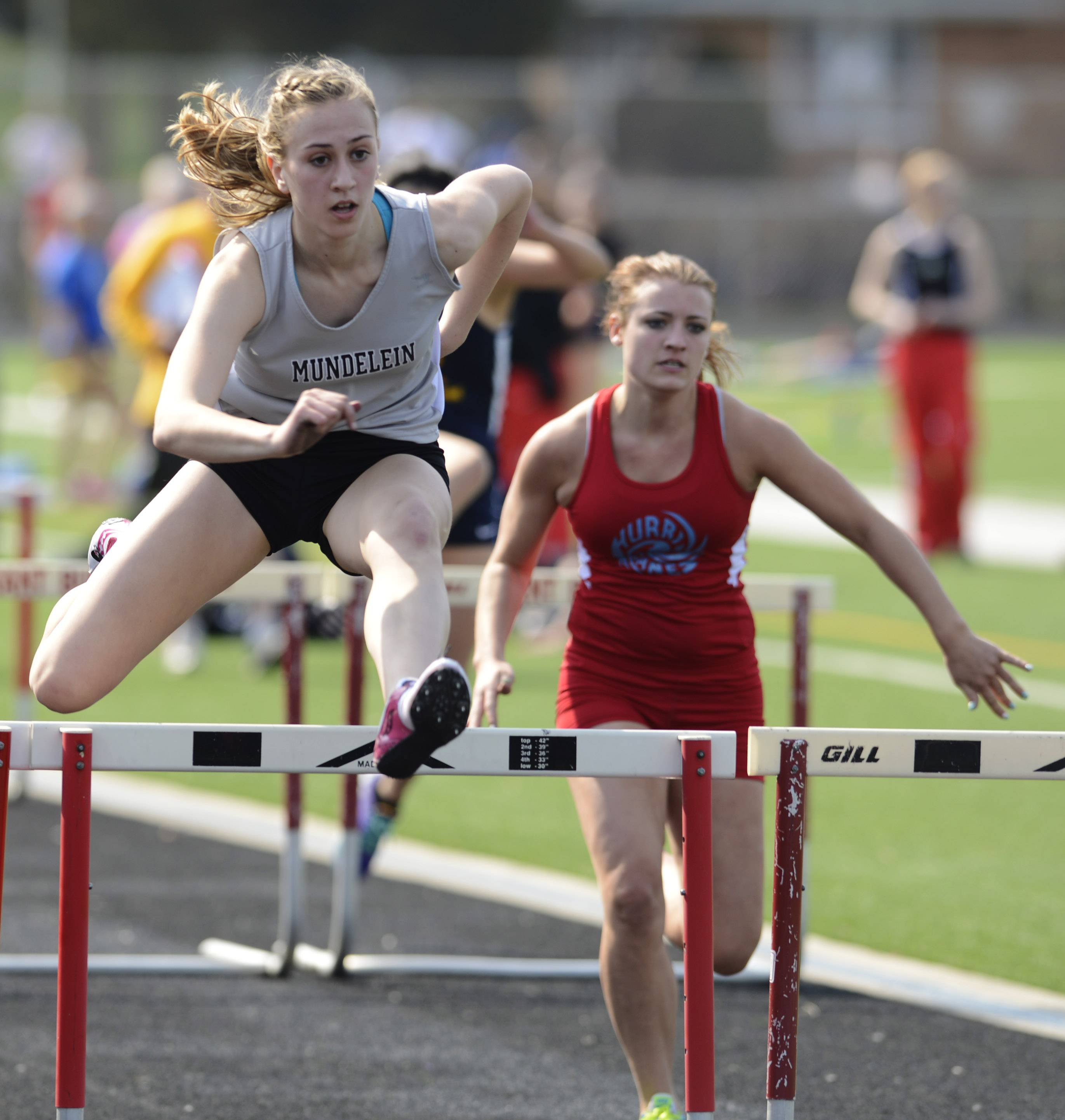 Mundelein's Katie Stanczykiewicz clears the last hurdle during the 100-meter high hurdles during Saturday's track meet at Grant High School in Fox Lake.
