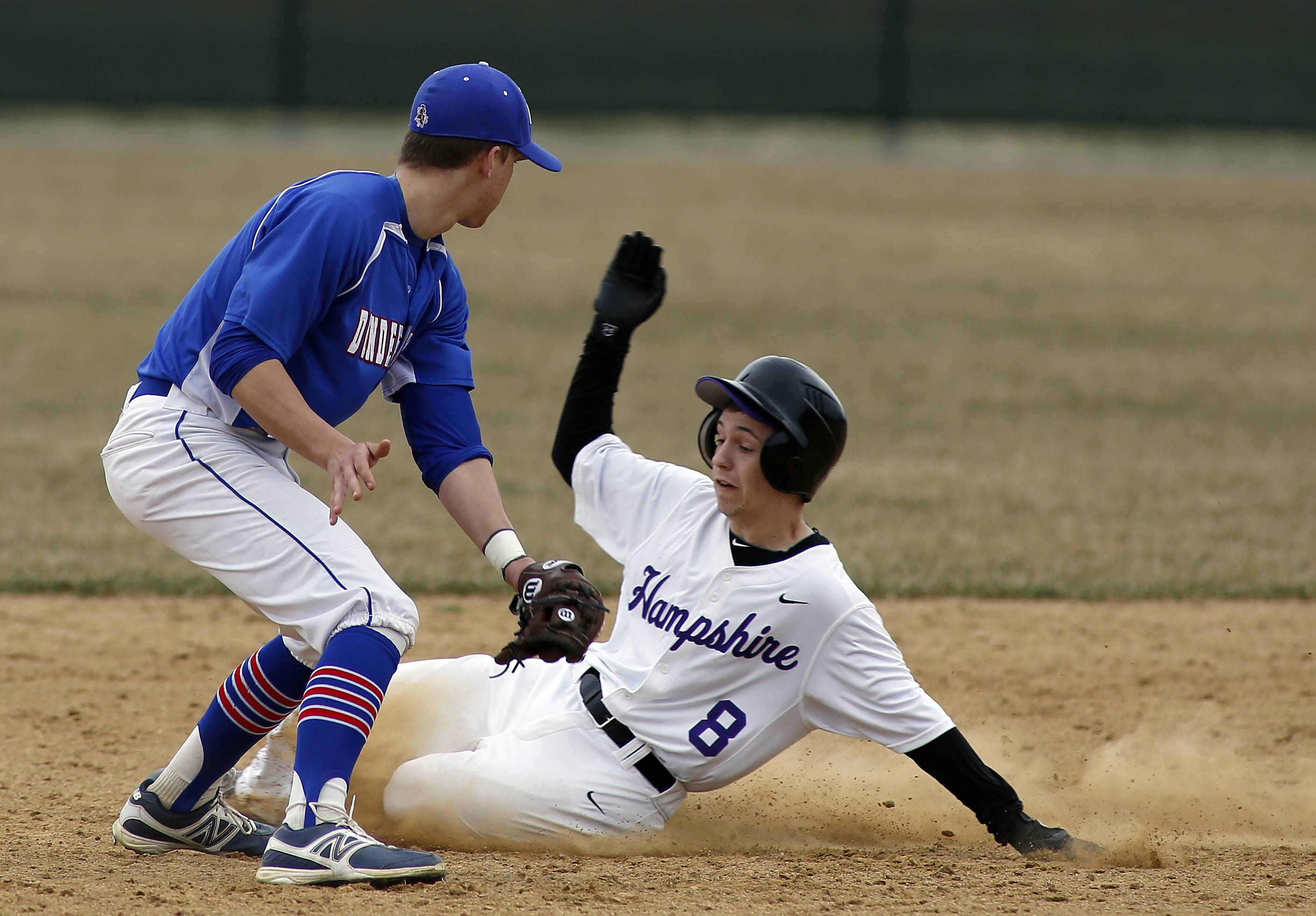 Dundee-Crown's Tyler Lewan tags out Hampshire's Michael Merchut at Hampshire on Saturday.