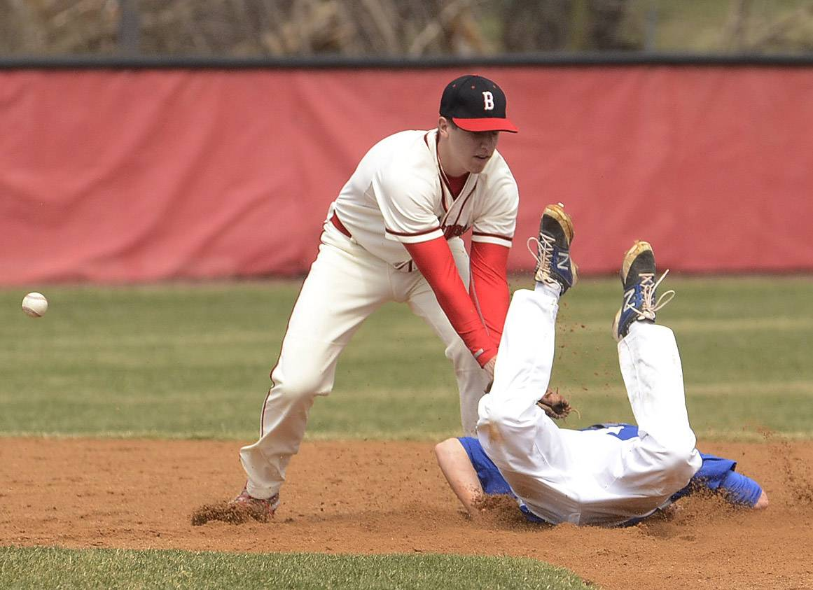 Burlington Central's Drew Wiss dives safely into second base with a stolen base in the first inning at Barrington. The Broncos went on to win 7-4.