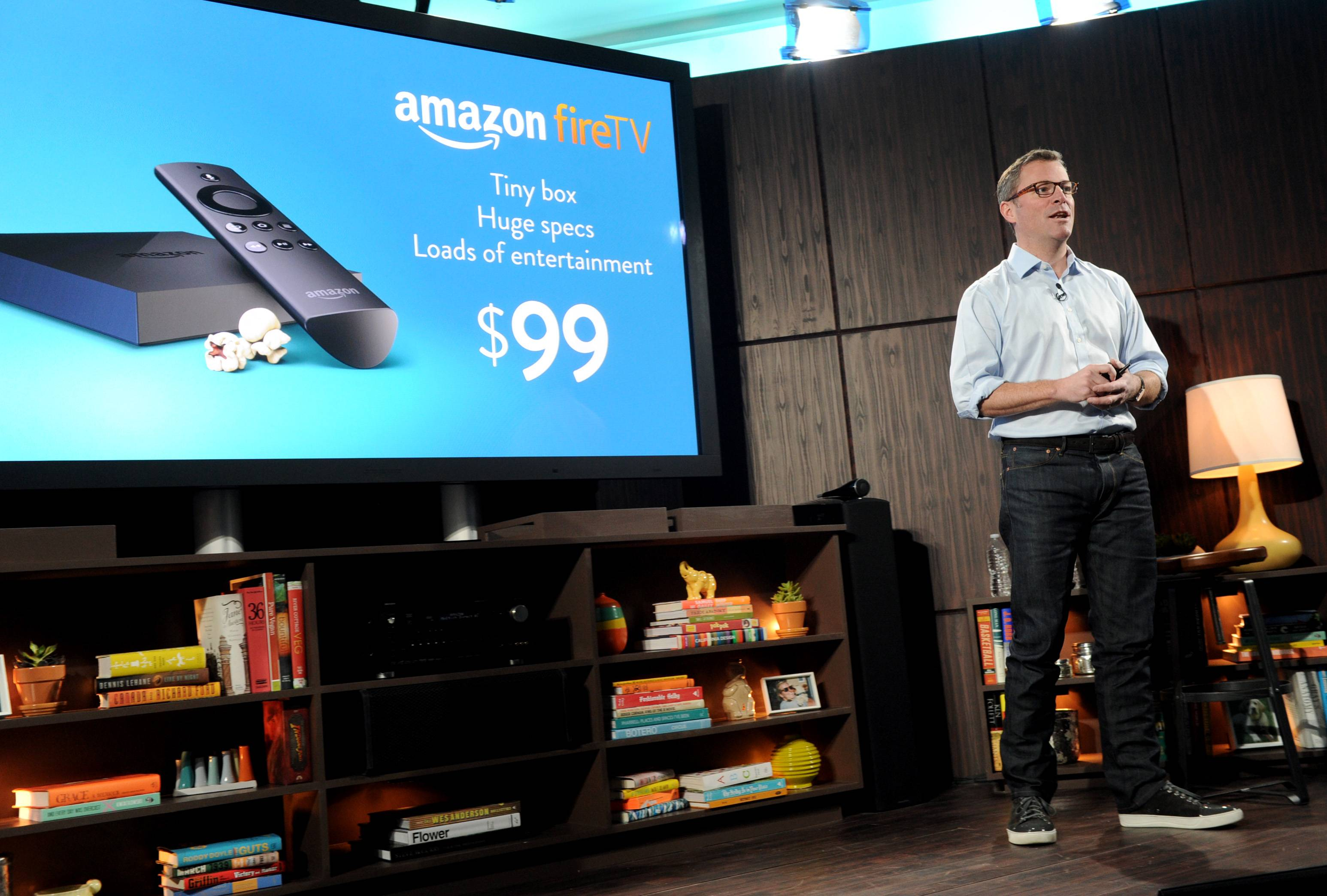 Amazon's Peter Larsen introduces Amazon Fire TV during a news conference in New York.